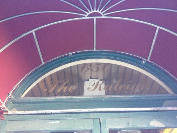 """""""The Raleigh"""" lettering remains over the front entrance doors. The canopy cover the old hotel's name unless you get close enough to the entrance."""