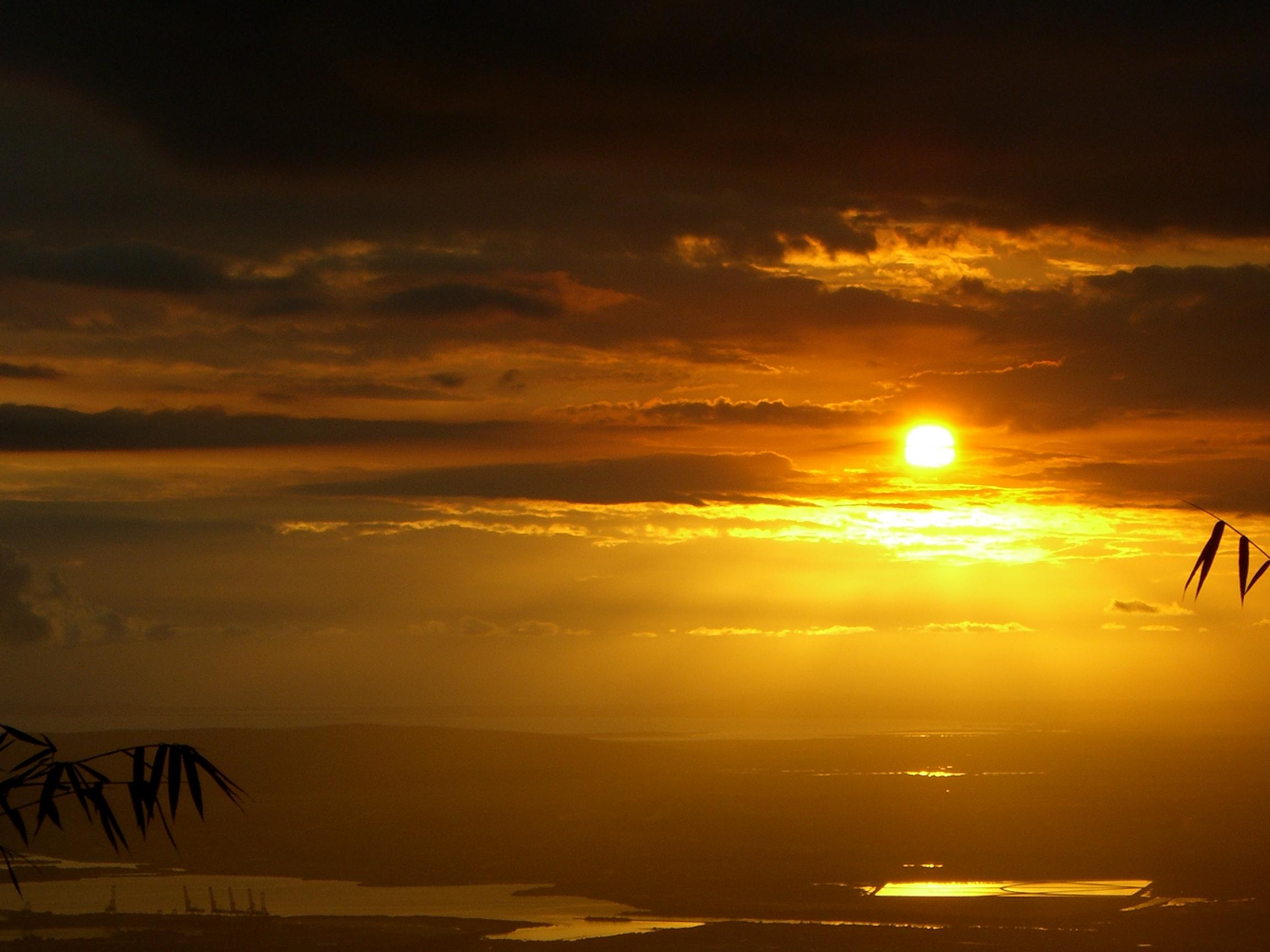 sun setting over Kingston, Jamaica