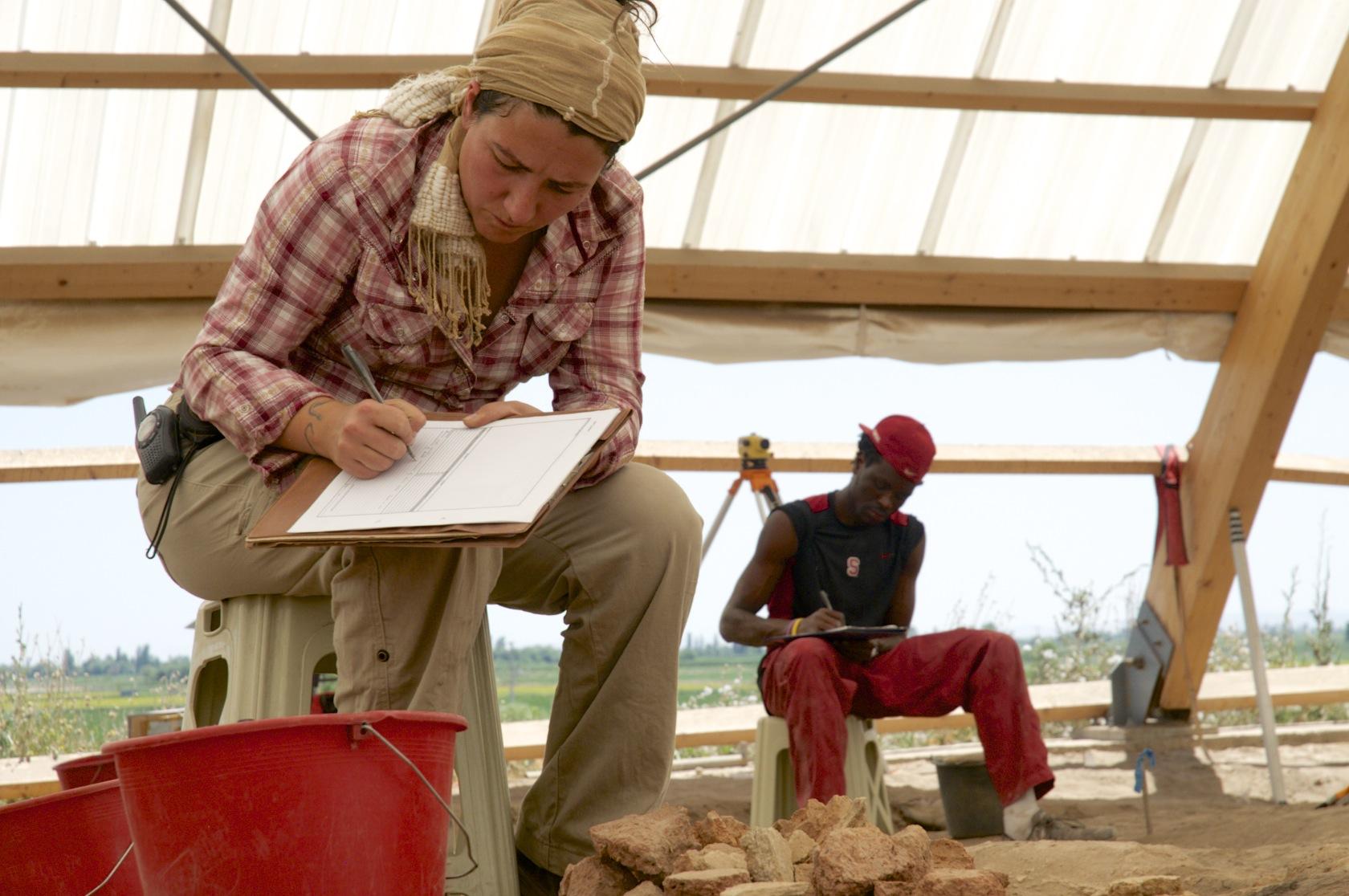 North Area director, Burcu Tung, and Stanford field school student Billy Sawoyo Sankei documenting their excavation at Çatalhöyük, Turkey.