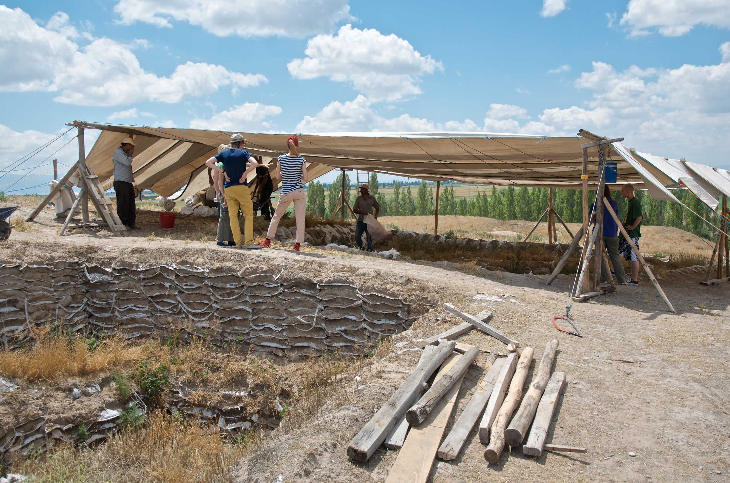 Çatalhöyük team members inspecting the TP Connection excavation area at the beginning of the 2015 season.