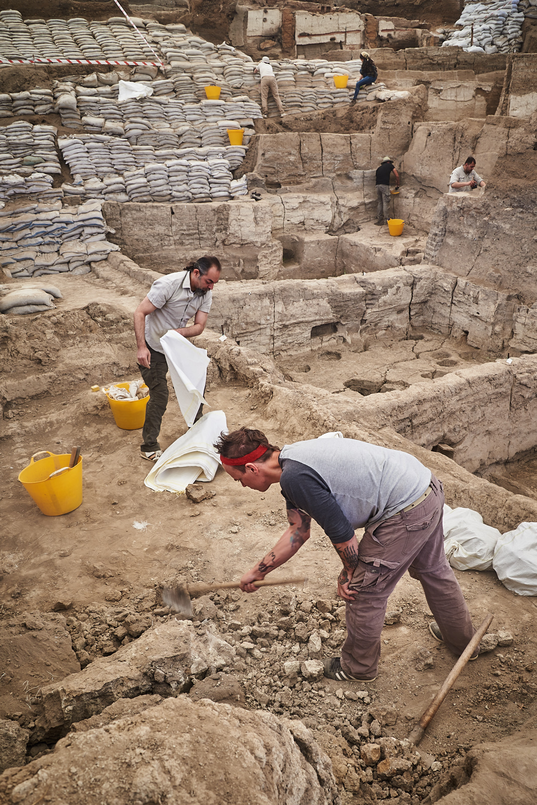 Thaer and Jerrod remove mudbrick wall collapse in the South excavation area.