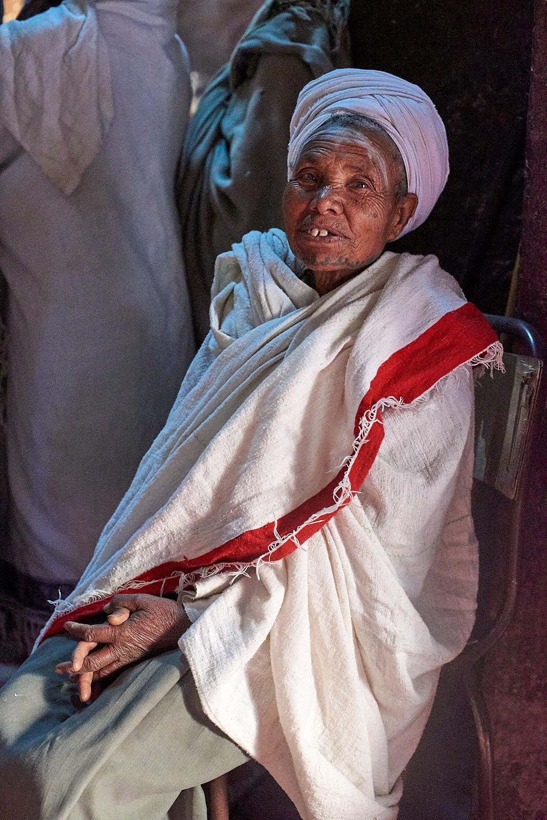 Ethiopian Orthodox pilgrim rests after prayers inside the Church of Saint George, Lalibela, Ethiopia.