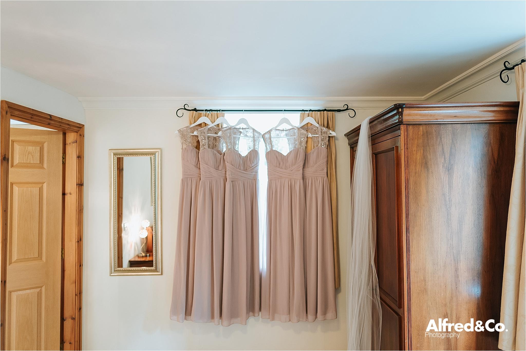 bridesmaids dresses hanging in window