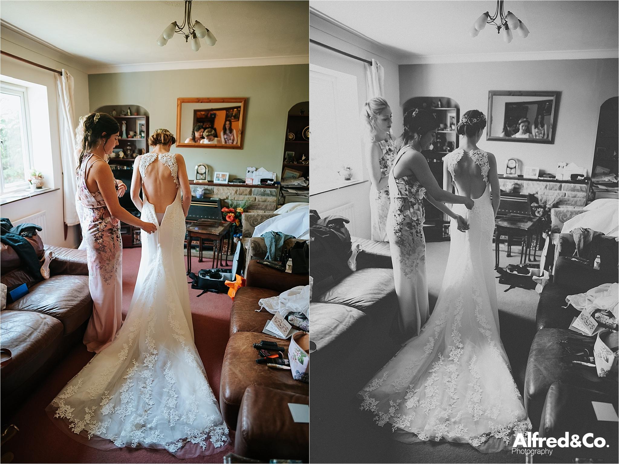 bride putting dress on before wedding
