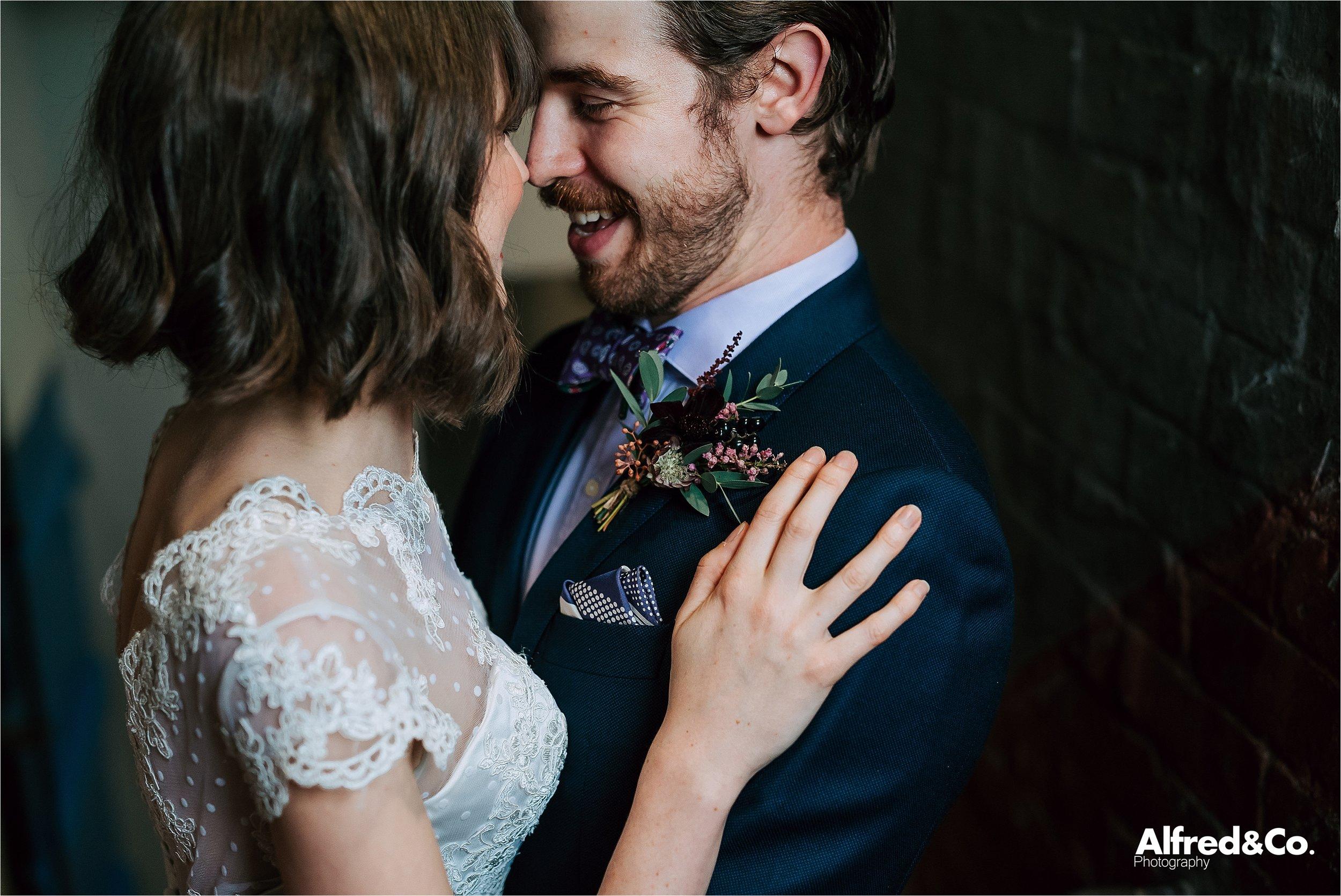 cute couple in rustic wedding venue