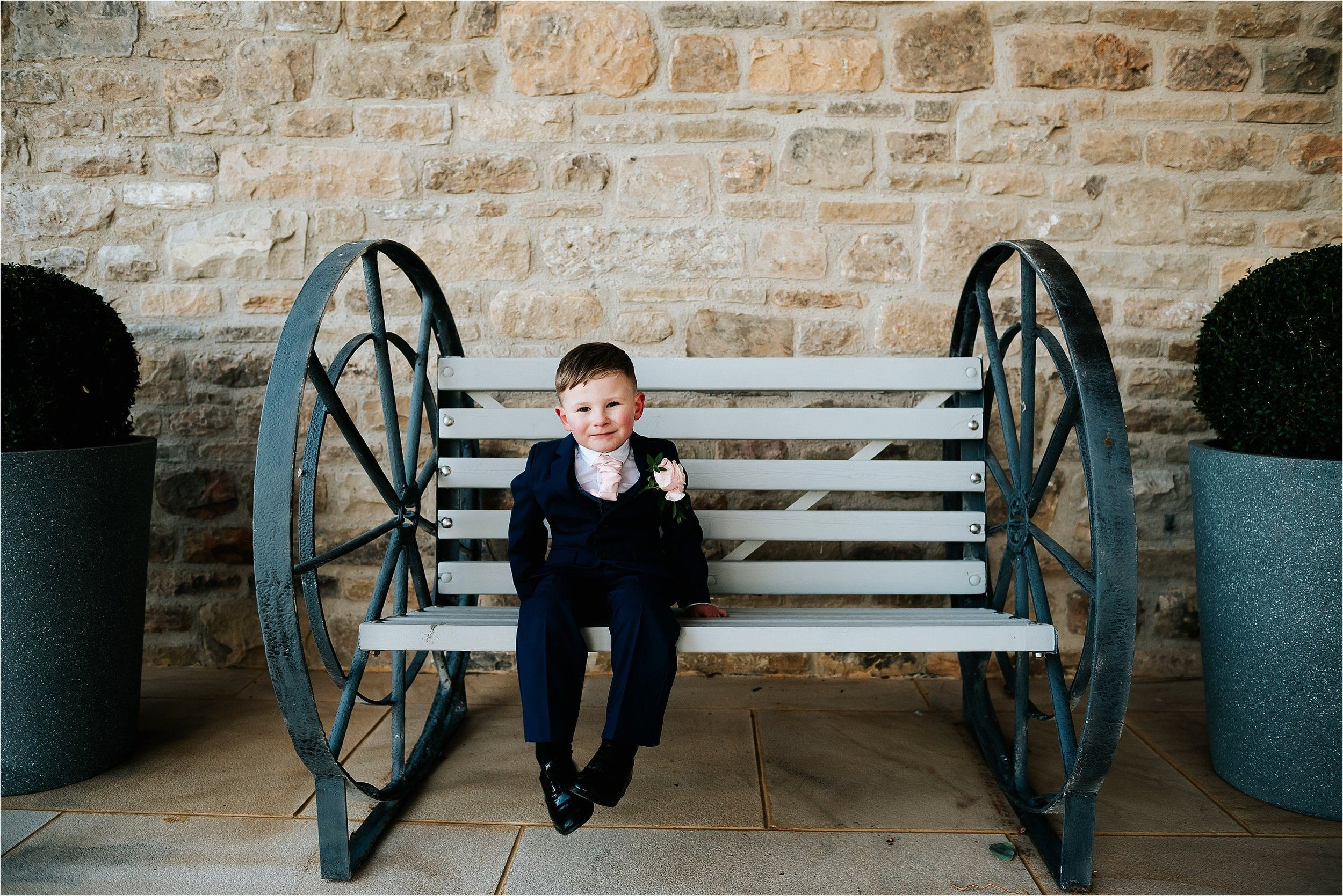 boy sitting down at wedding