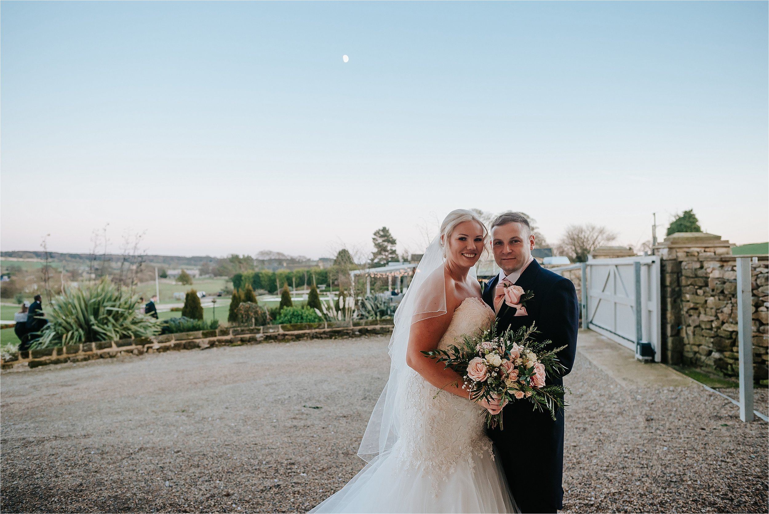 bride and groom as sun sets