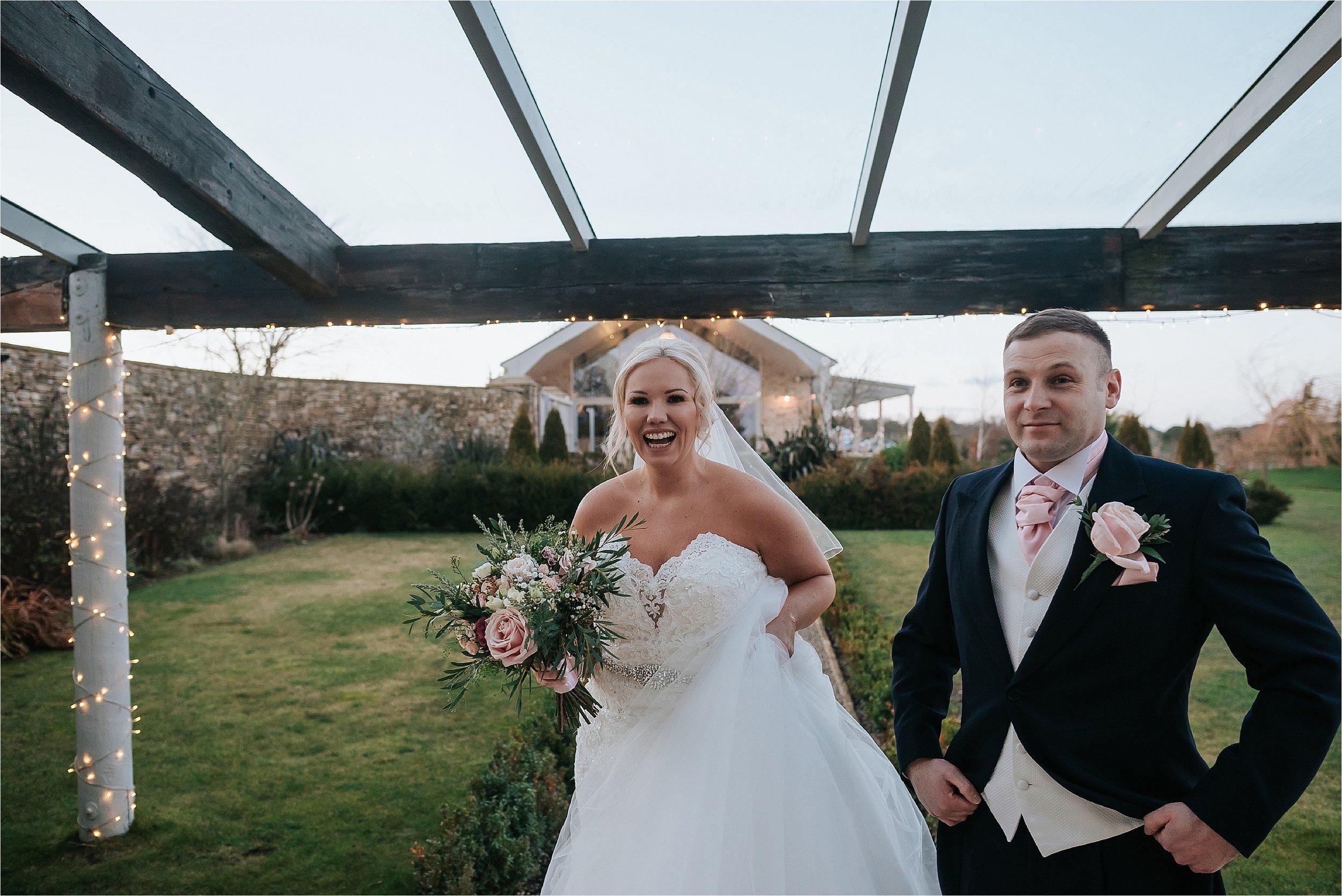 bride and groom outside yorkshire wedding barn