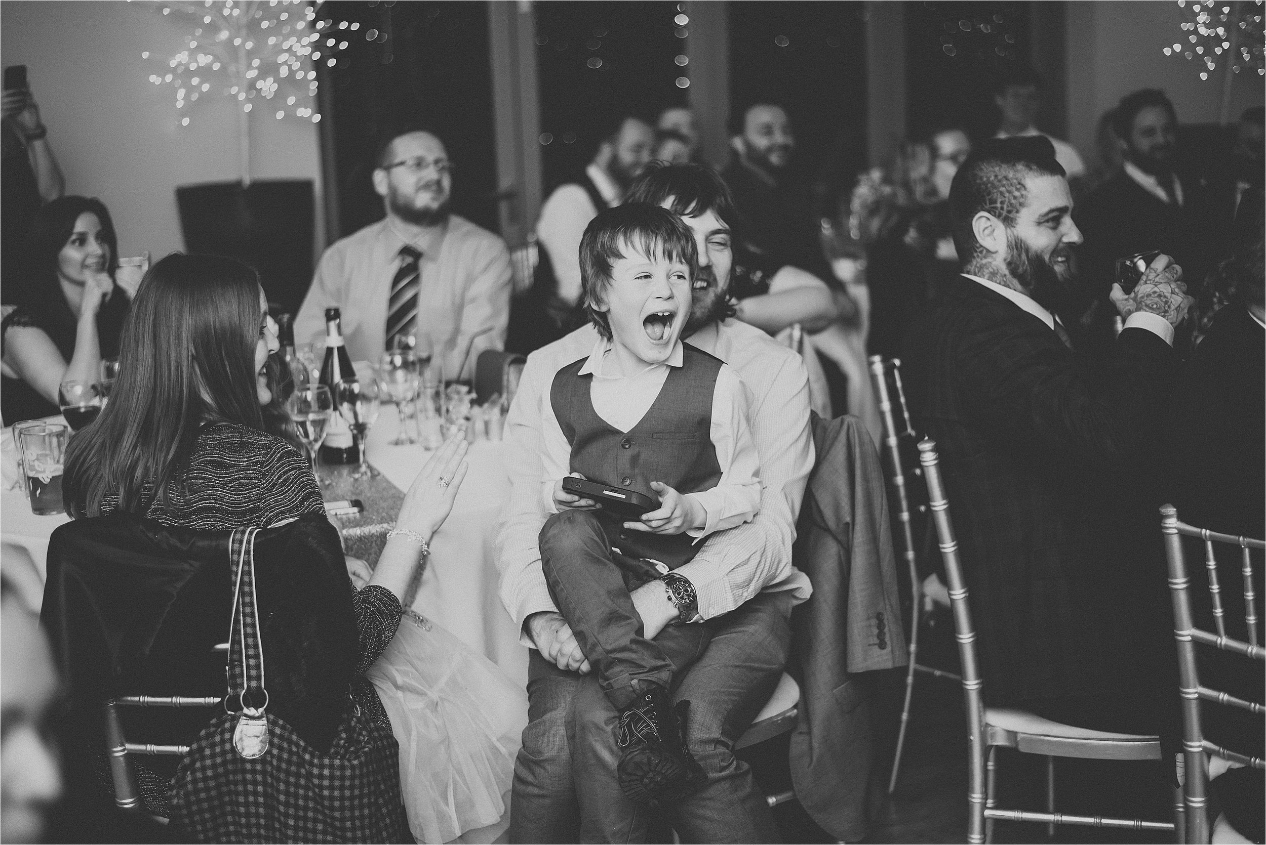 young boy laughing at speeches