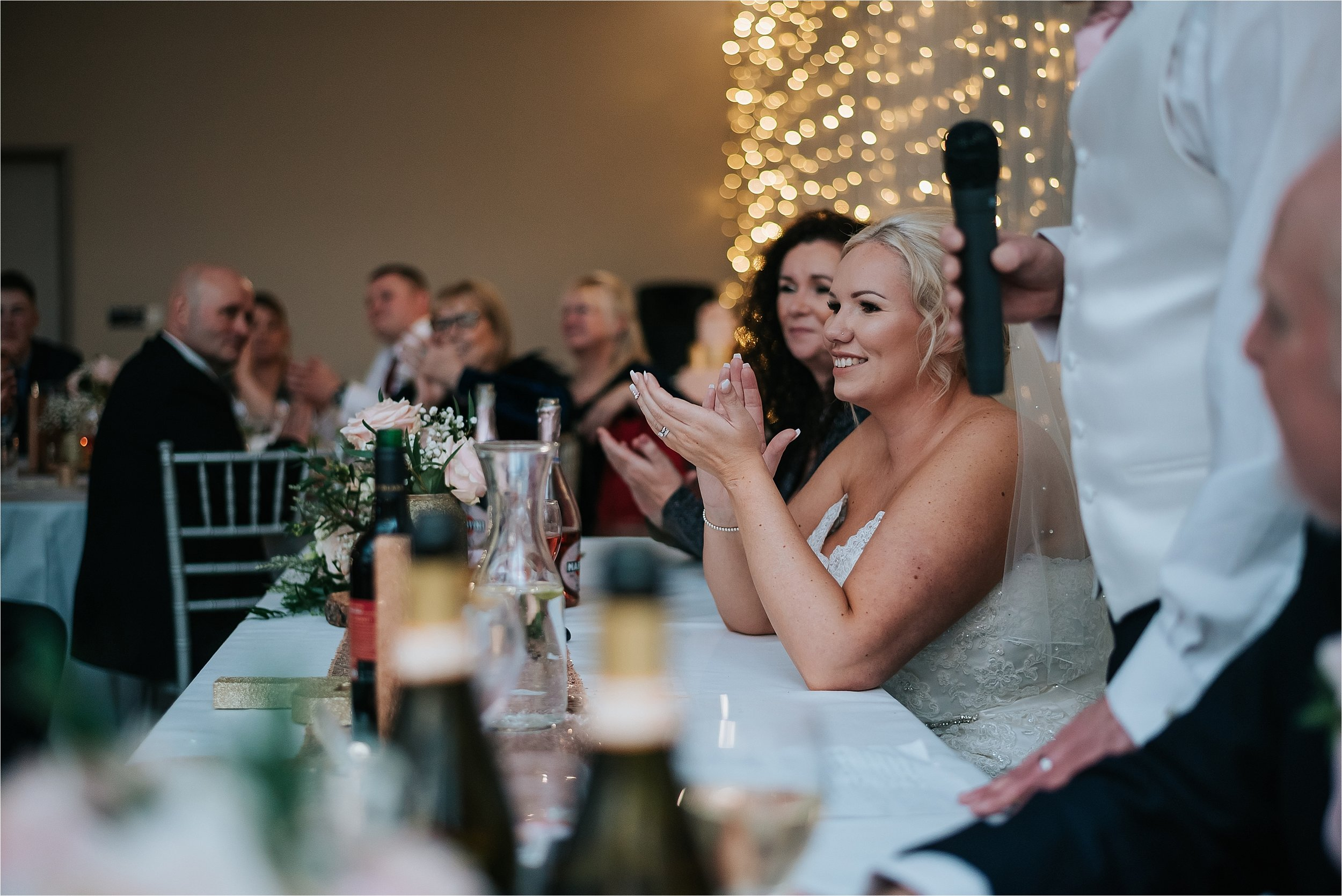 bride clapping at wedding speeches