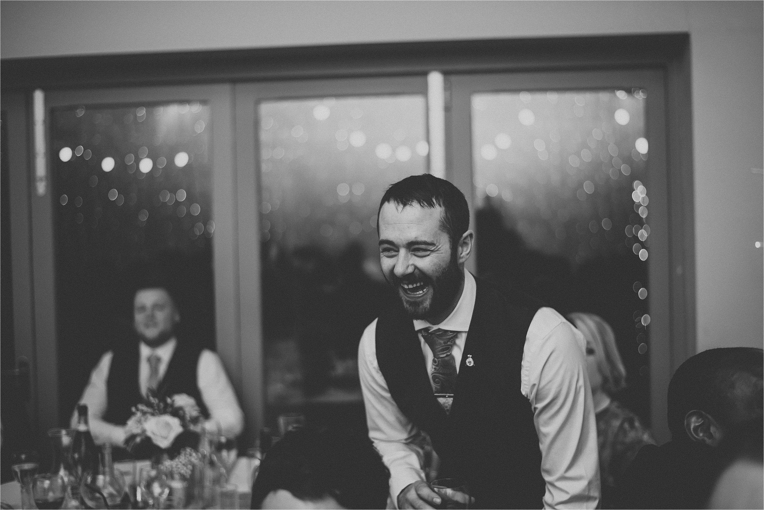man laughing at wedding party