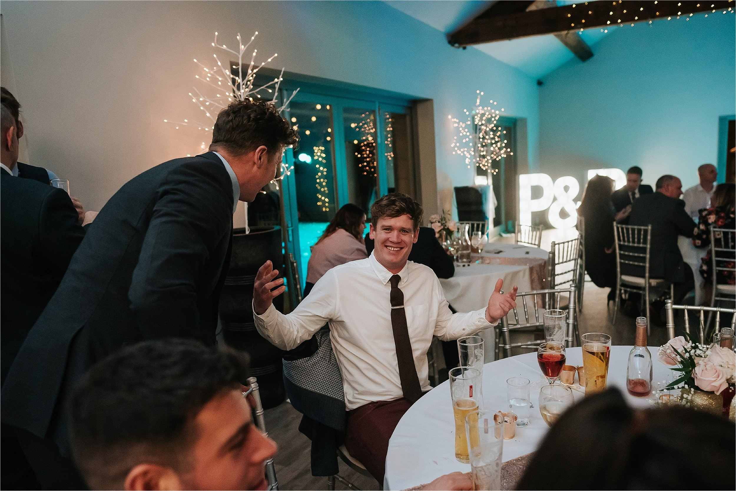 man laughing at winter wedding in yorkshire