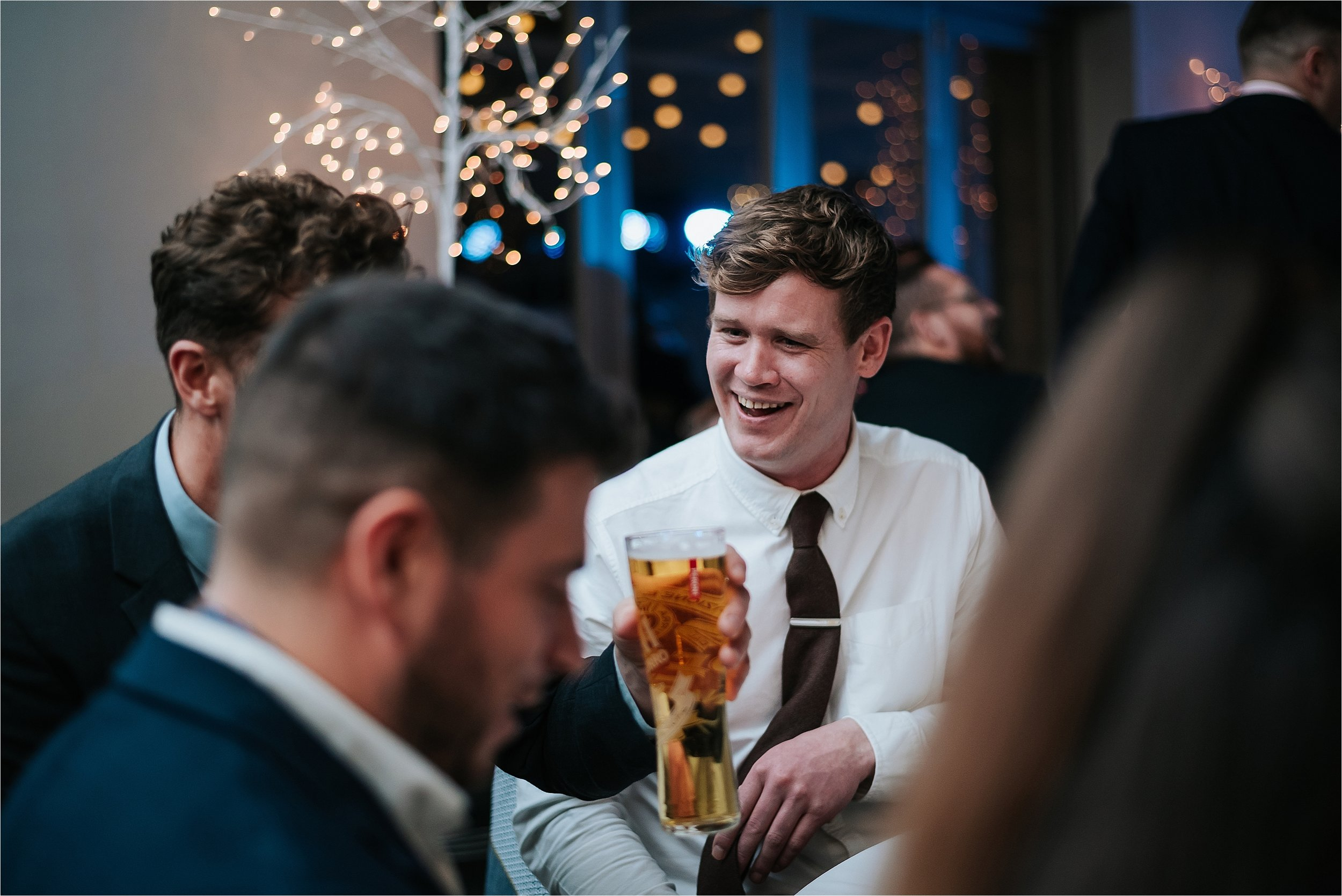 guy laughing at wedding party