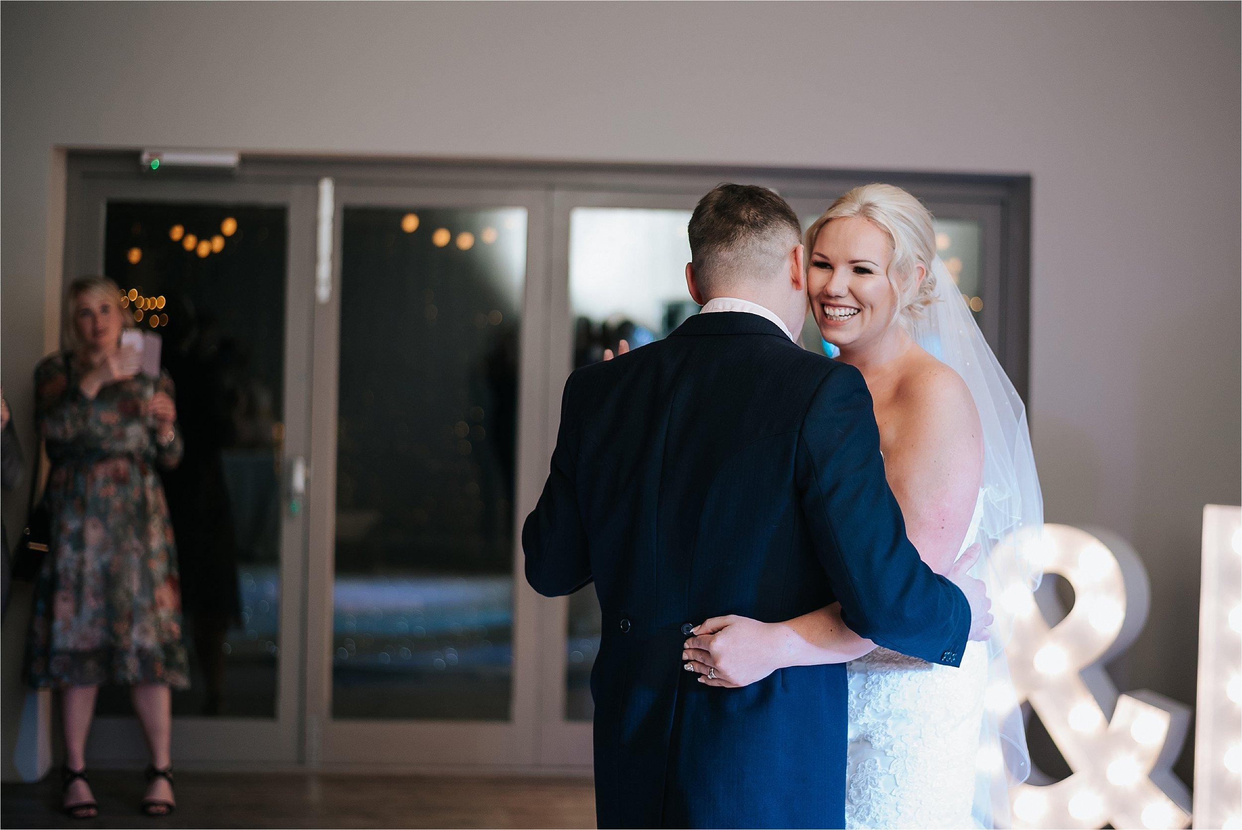 happy bride dancing at wedding
