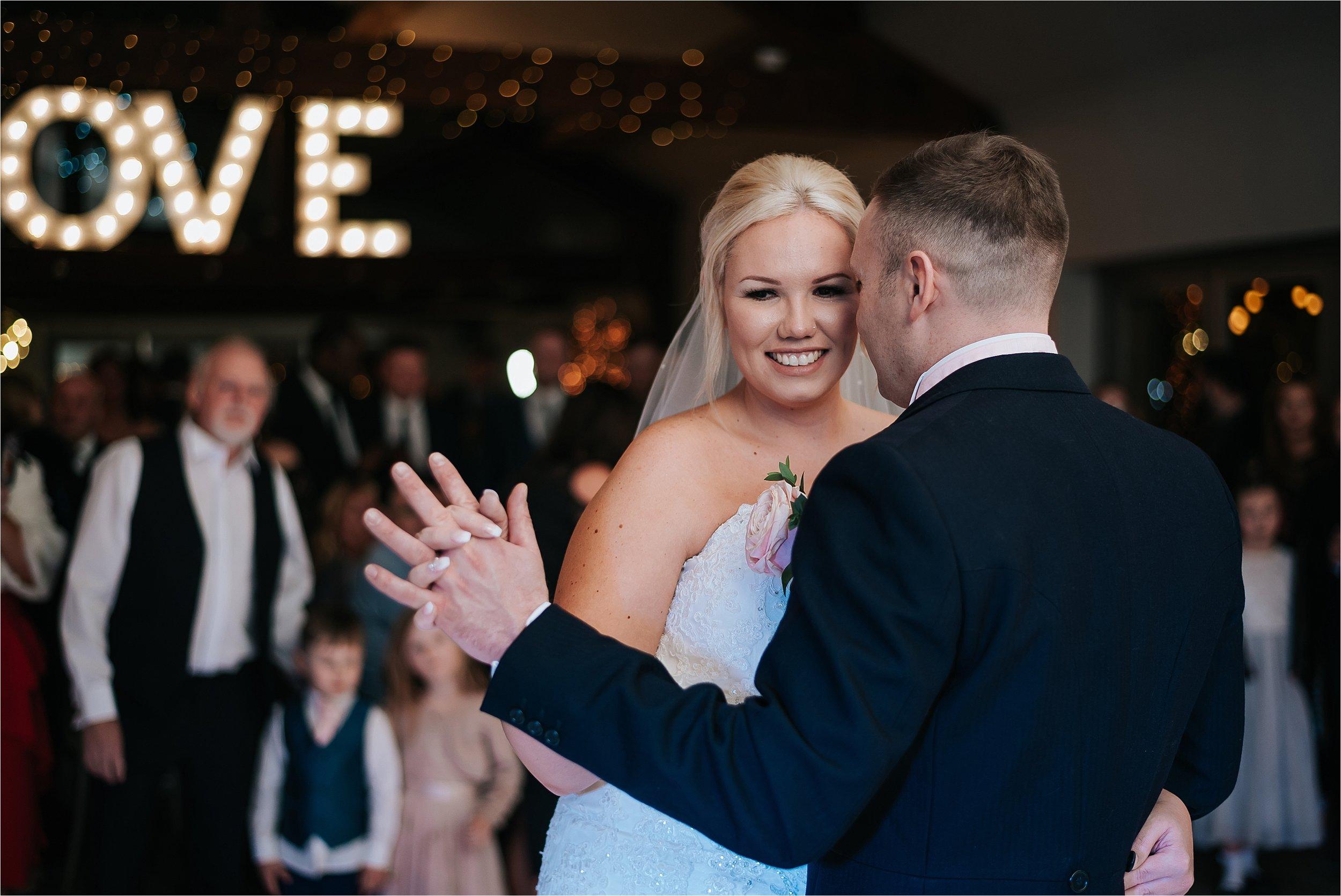 bride and groom enjoy first dance