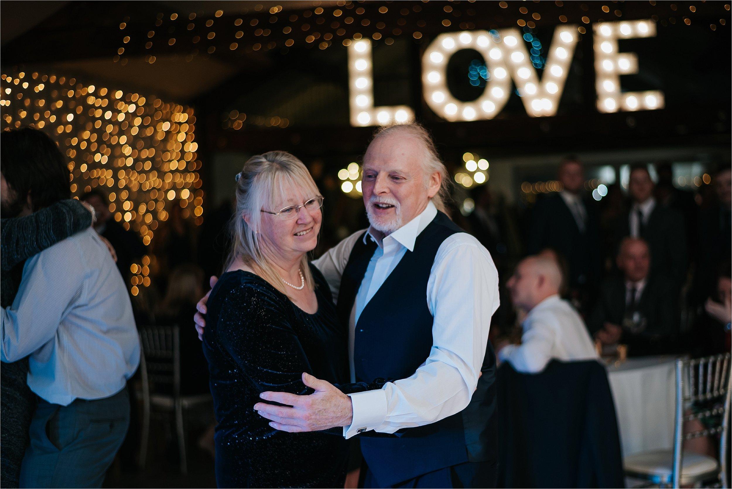 older couple dancing at wedding