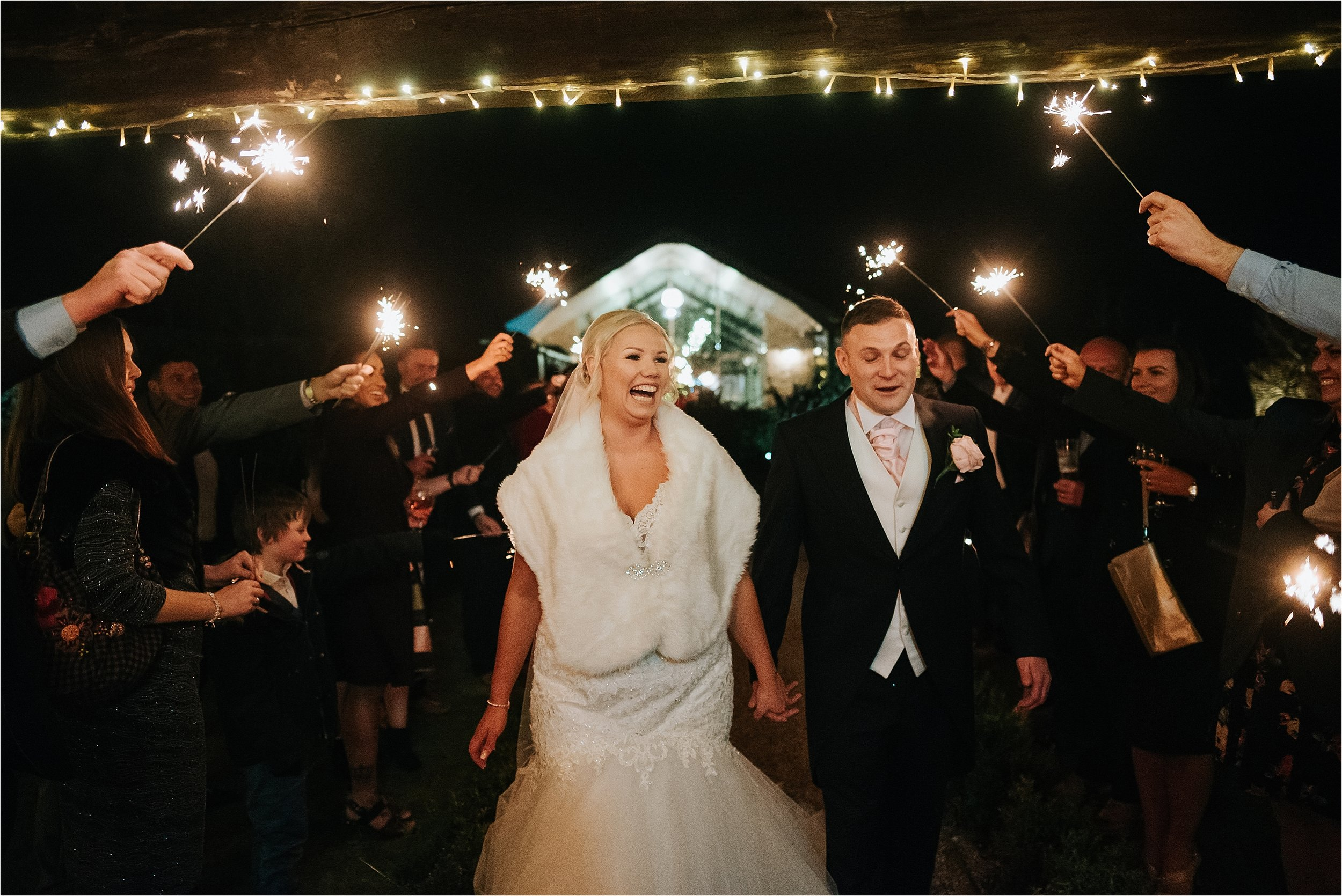 bride and groom and sparklers