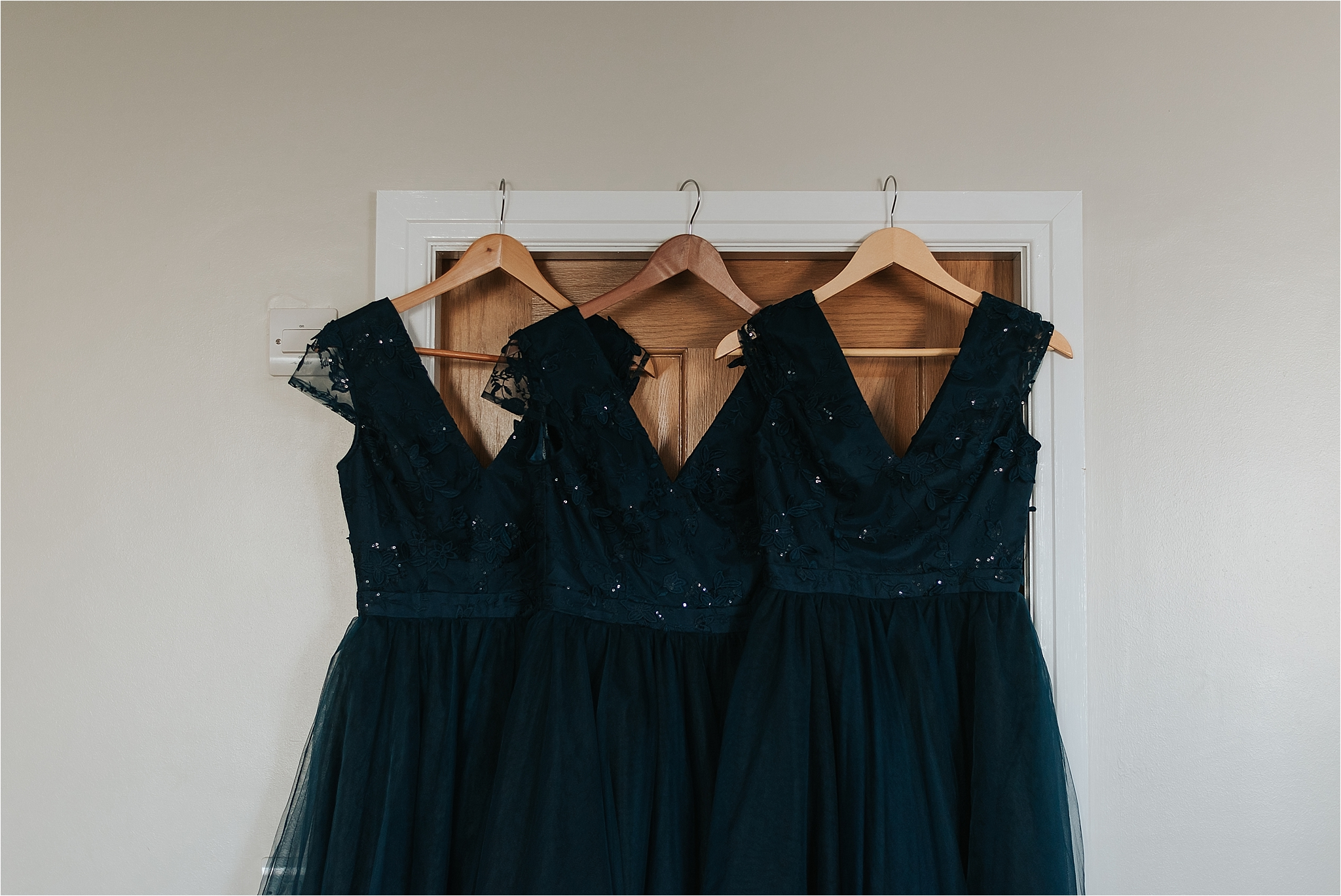 bridesmaid dresses hanging on door