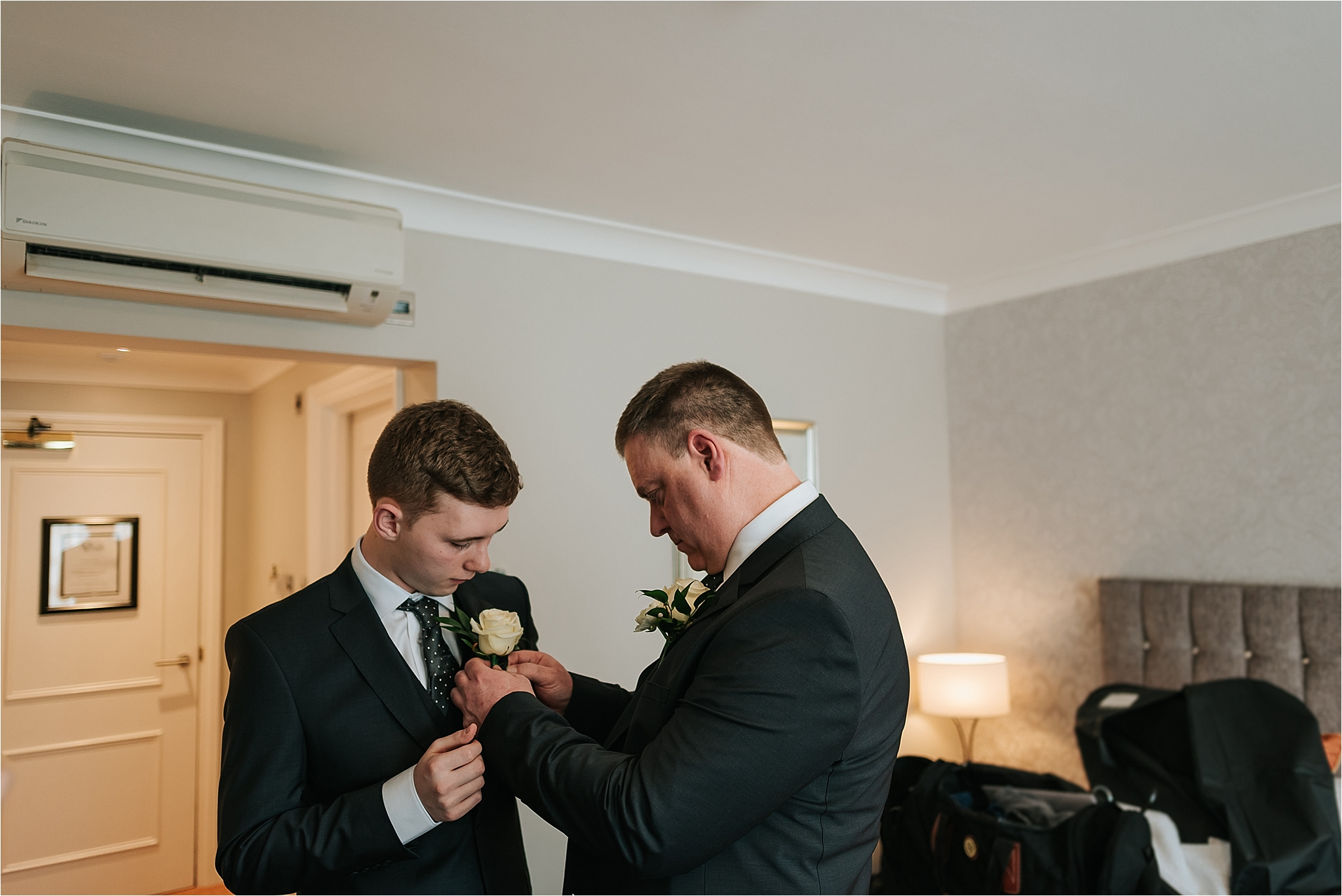 father and son get ready for wedding