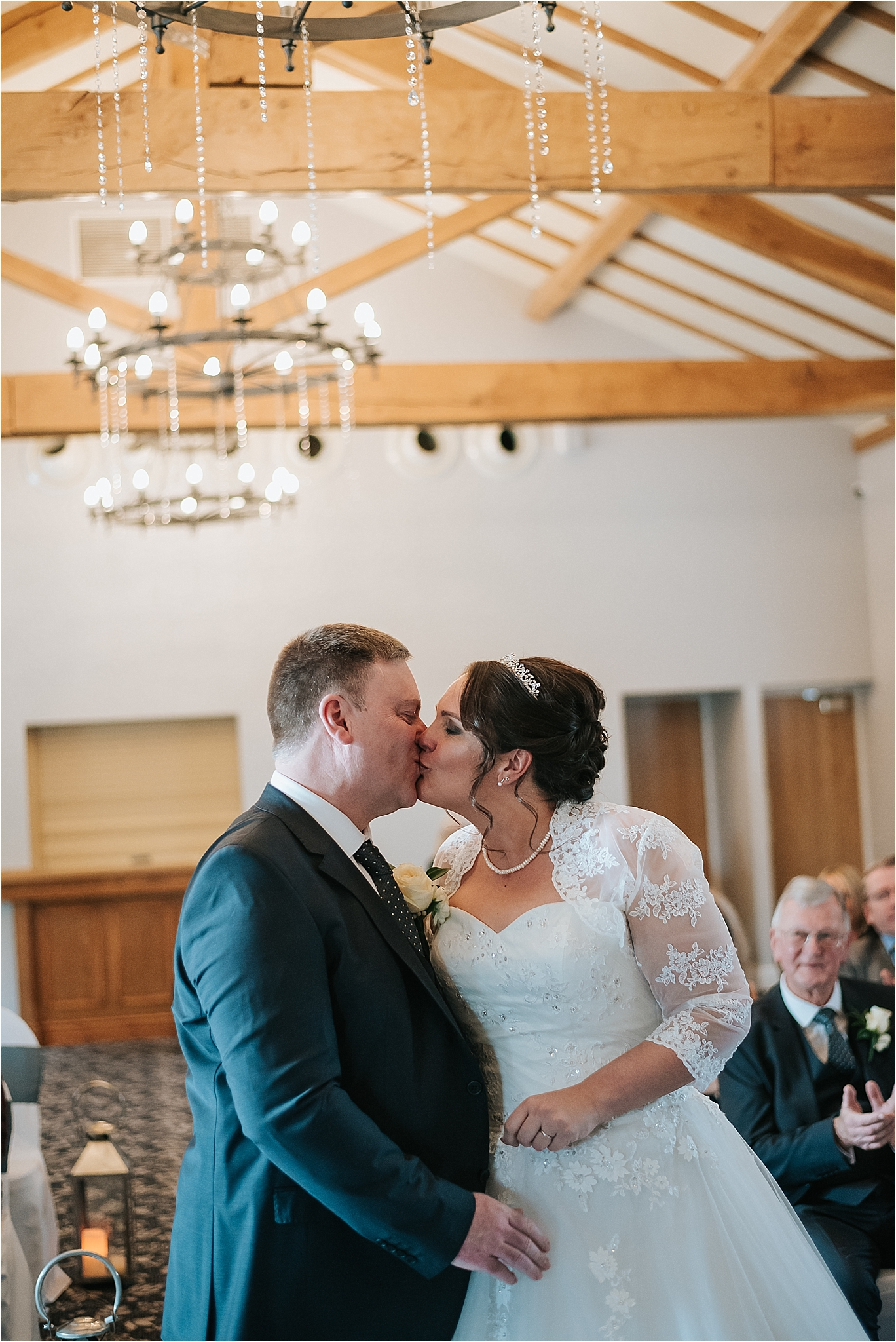 couple kissing at wedding at the villa wrea green