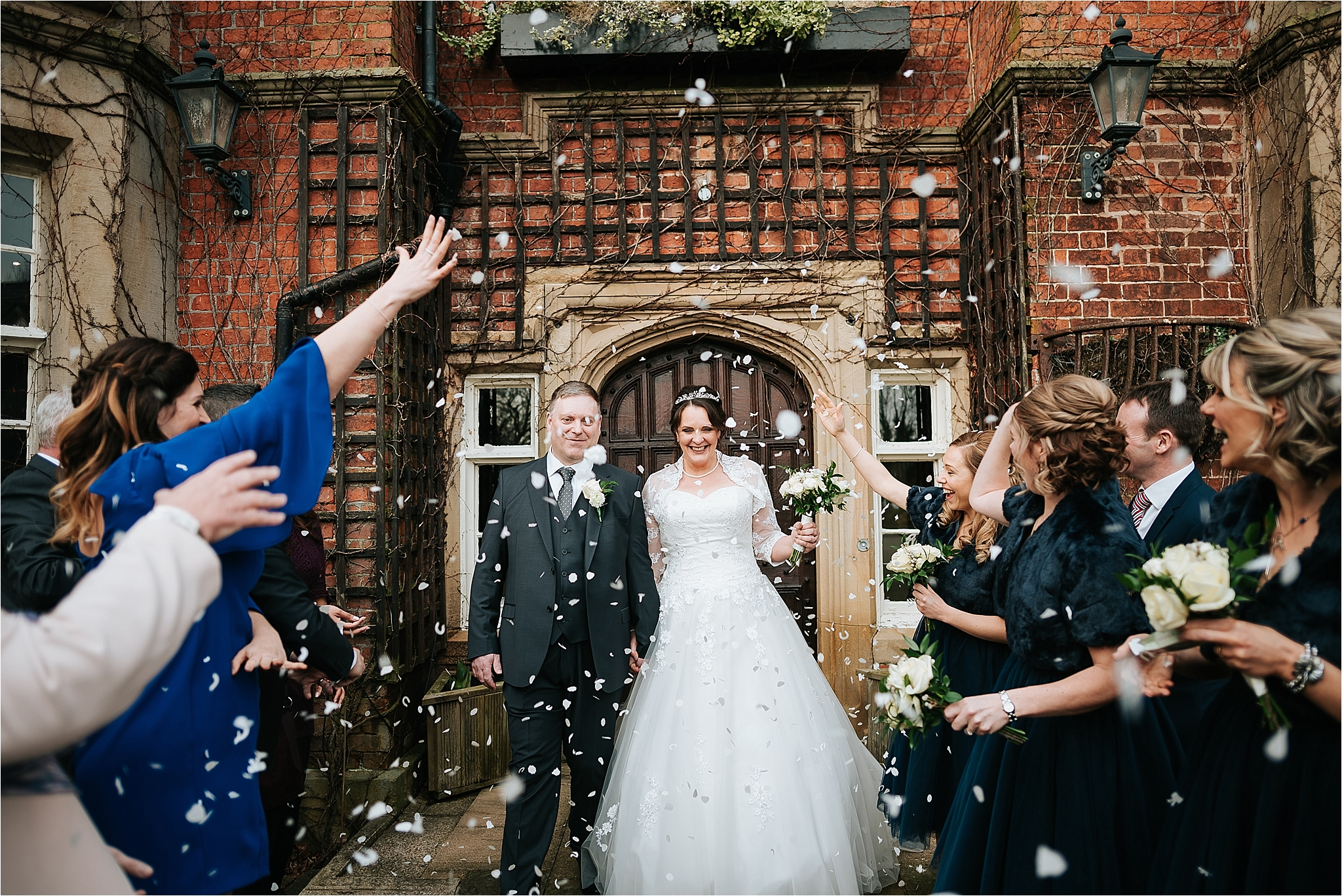 couple walking through confetti at the villa wrea green