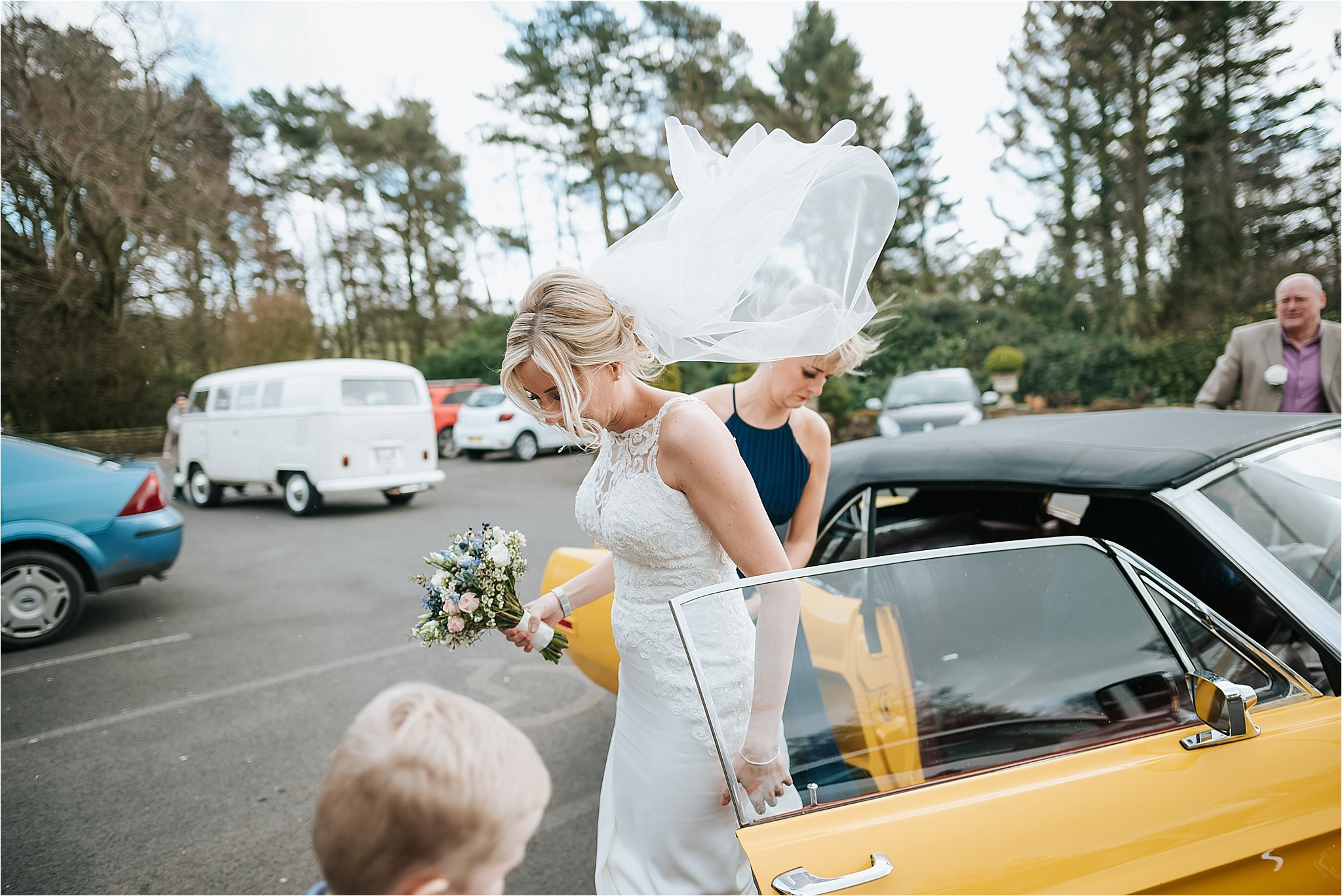 bride gets out of car for wedding at ferraris country house