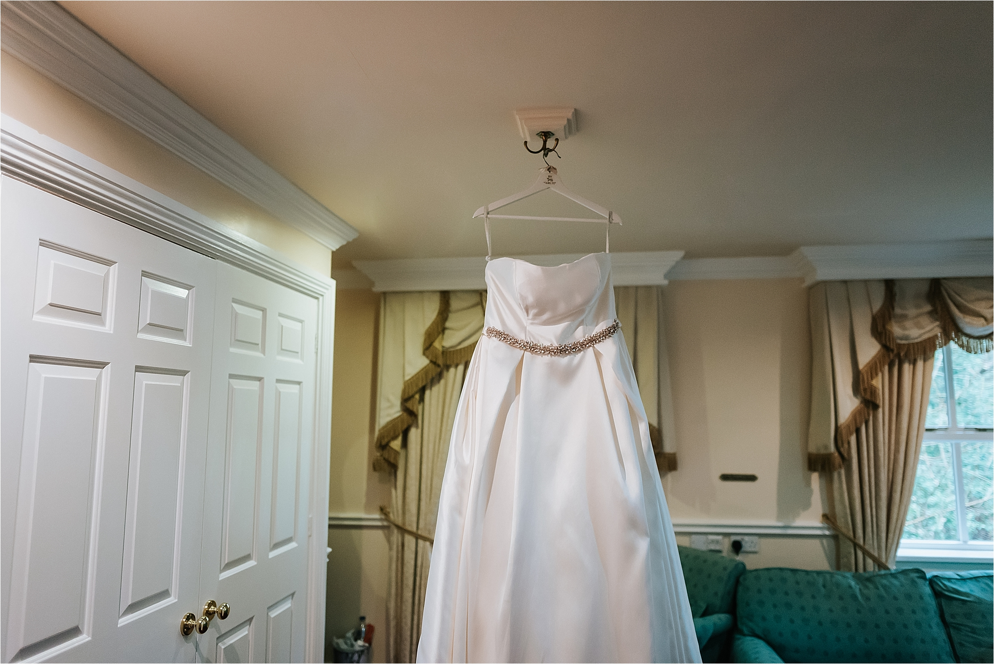 wedding dress from wed2be hangs up