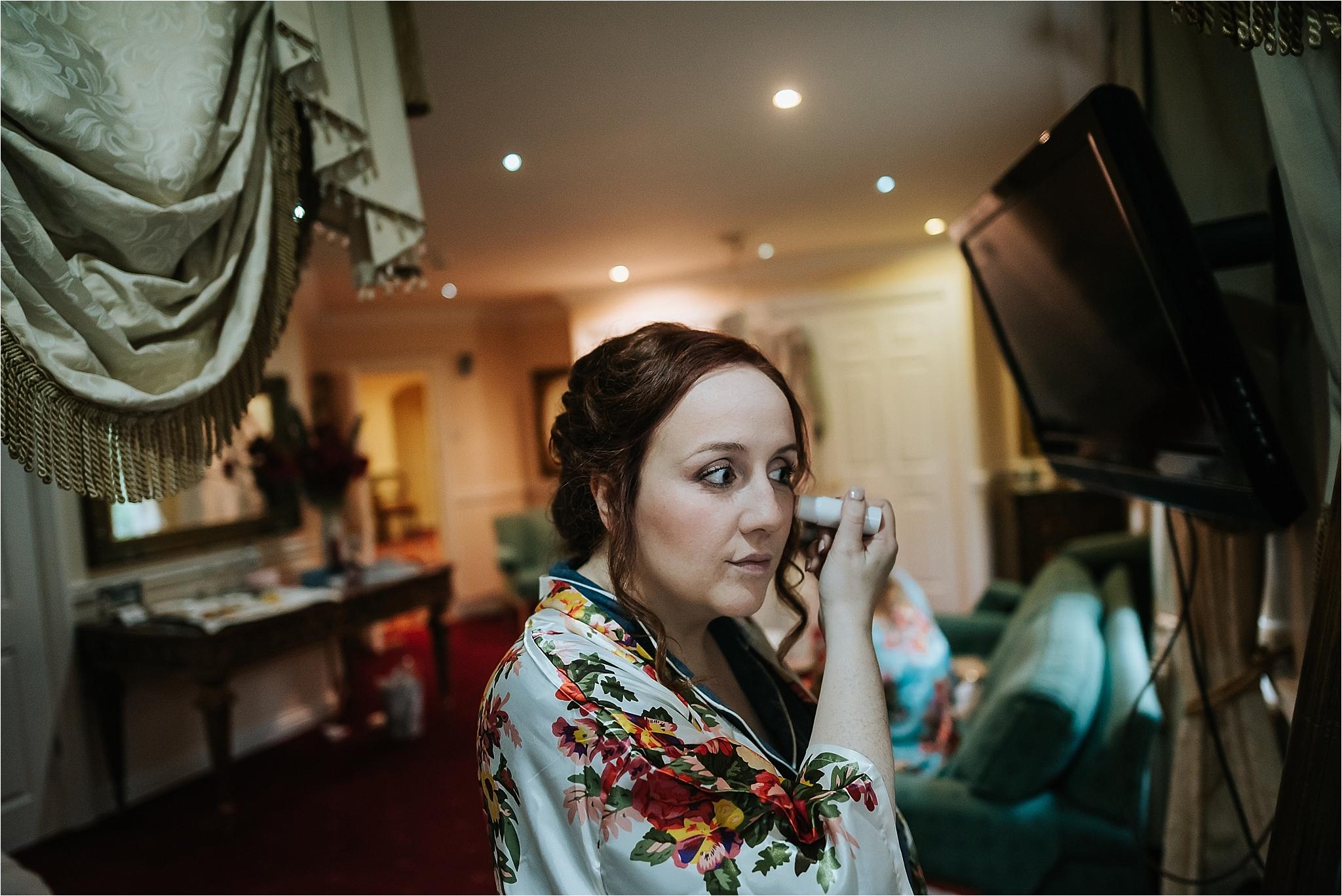 bride does make up at grange hotel wedding venue