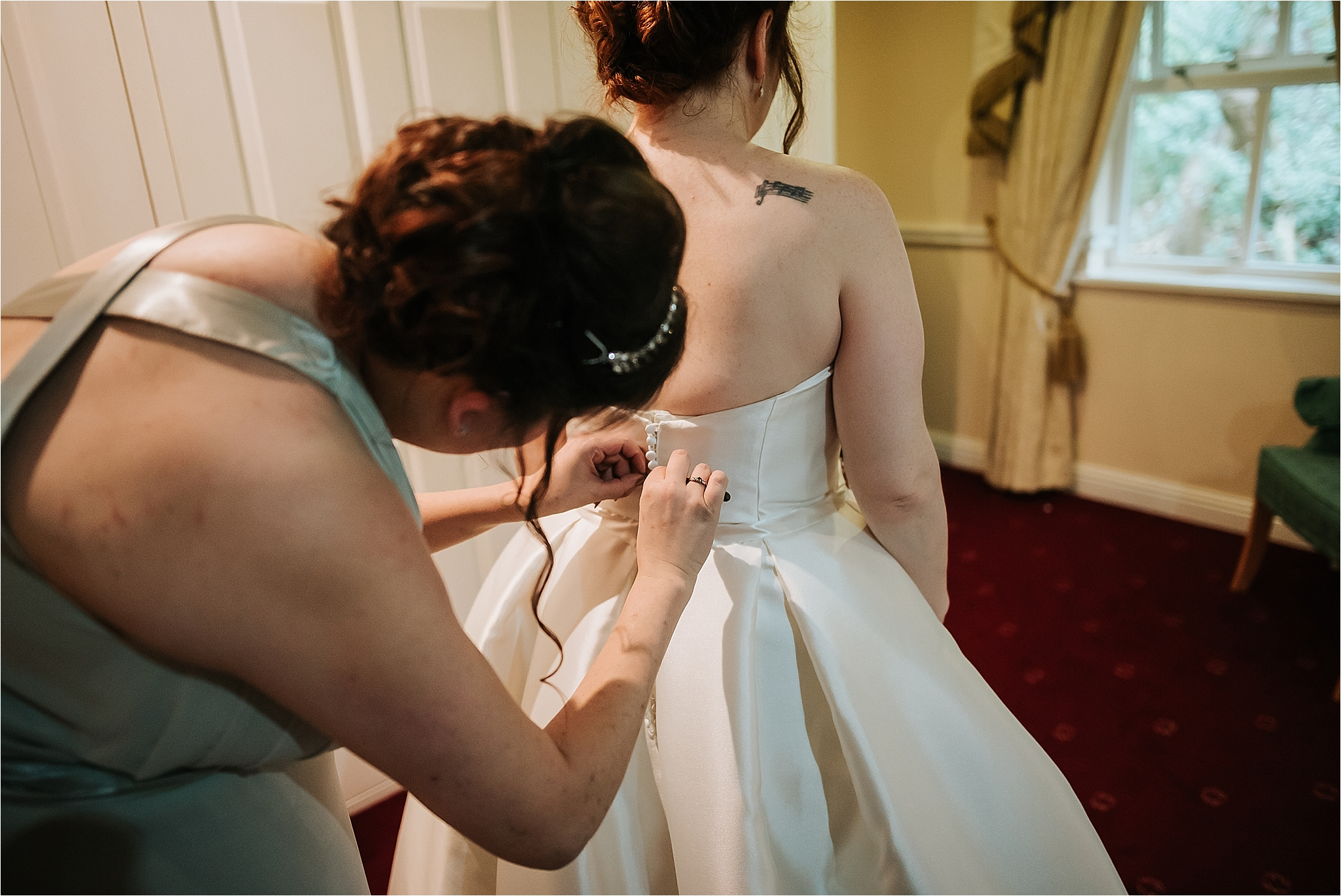 bride gets dress on at grange hotel