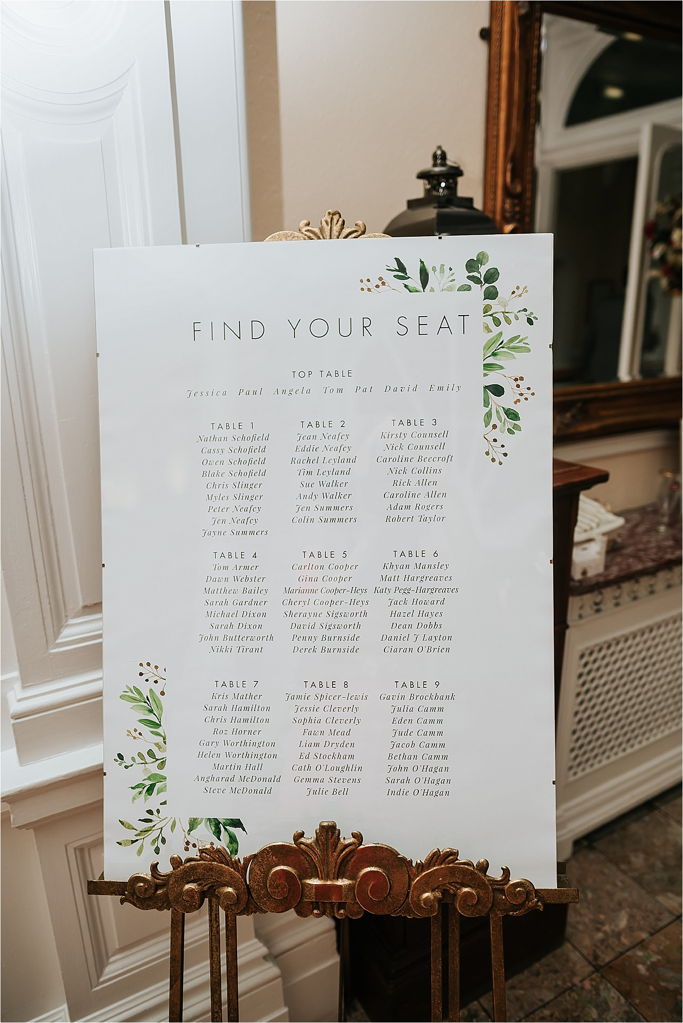 table plan at spring wedding with green foliage design