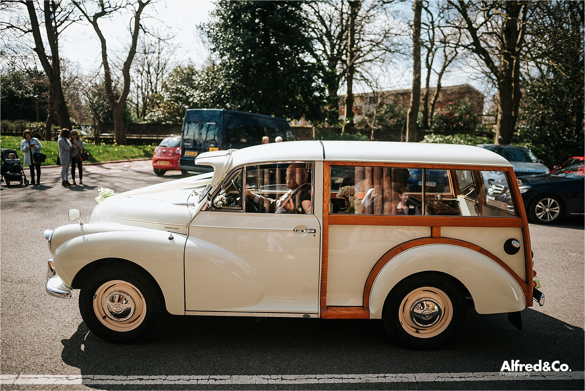 bride arrives in wedding car at mossley hill church liverpool