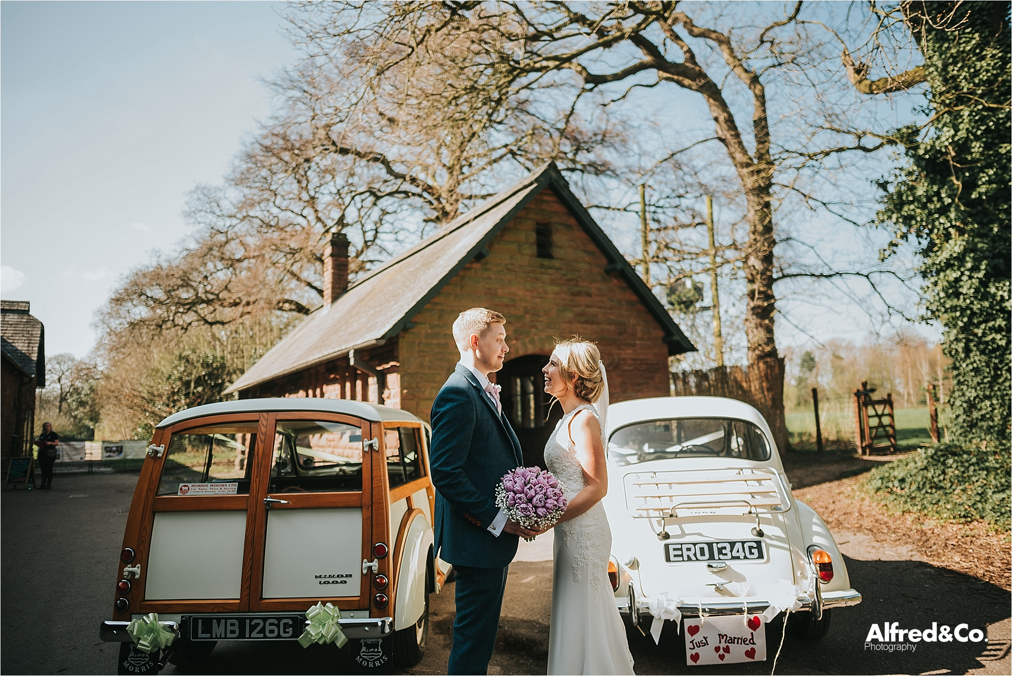 bride and groom with classic cars