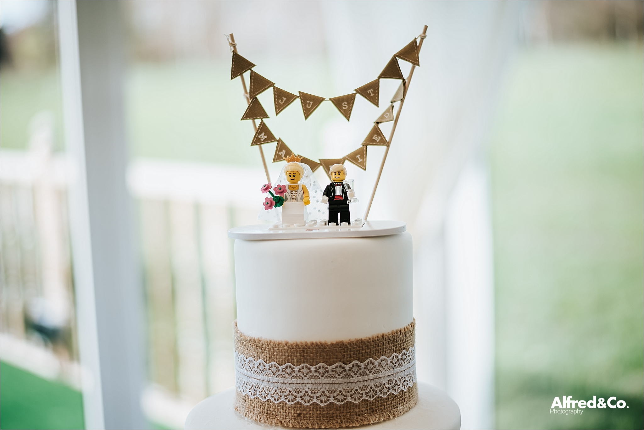 wedding cake with lego cake topper