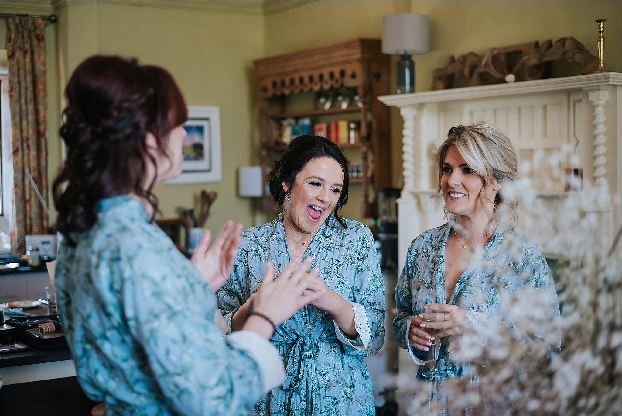 bridesmaids laugh before wedding