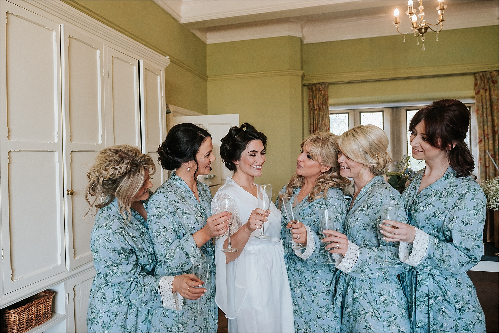 bridesmaids and bride before boho wedding