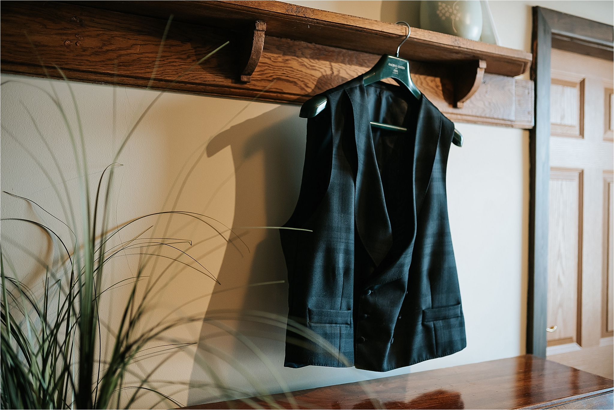 mans waistcoat hanging on picture rail