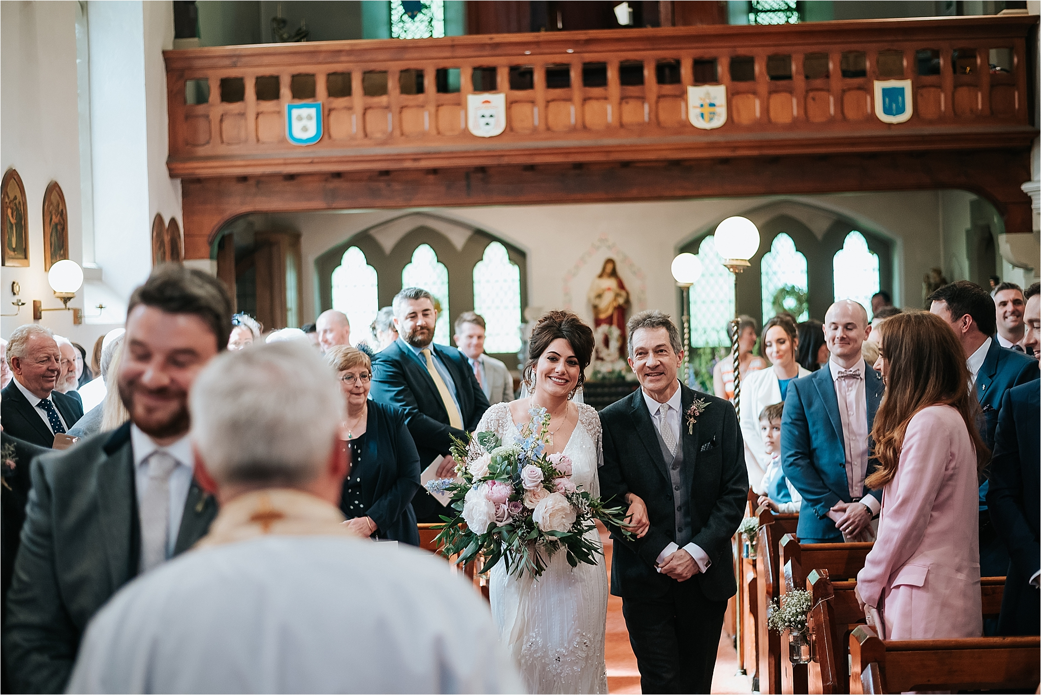 bride walks up the aisle at st marys and st james church scorton