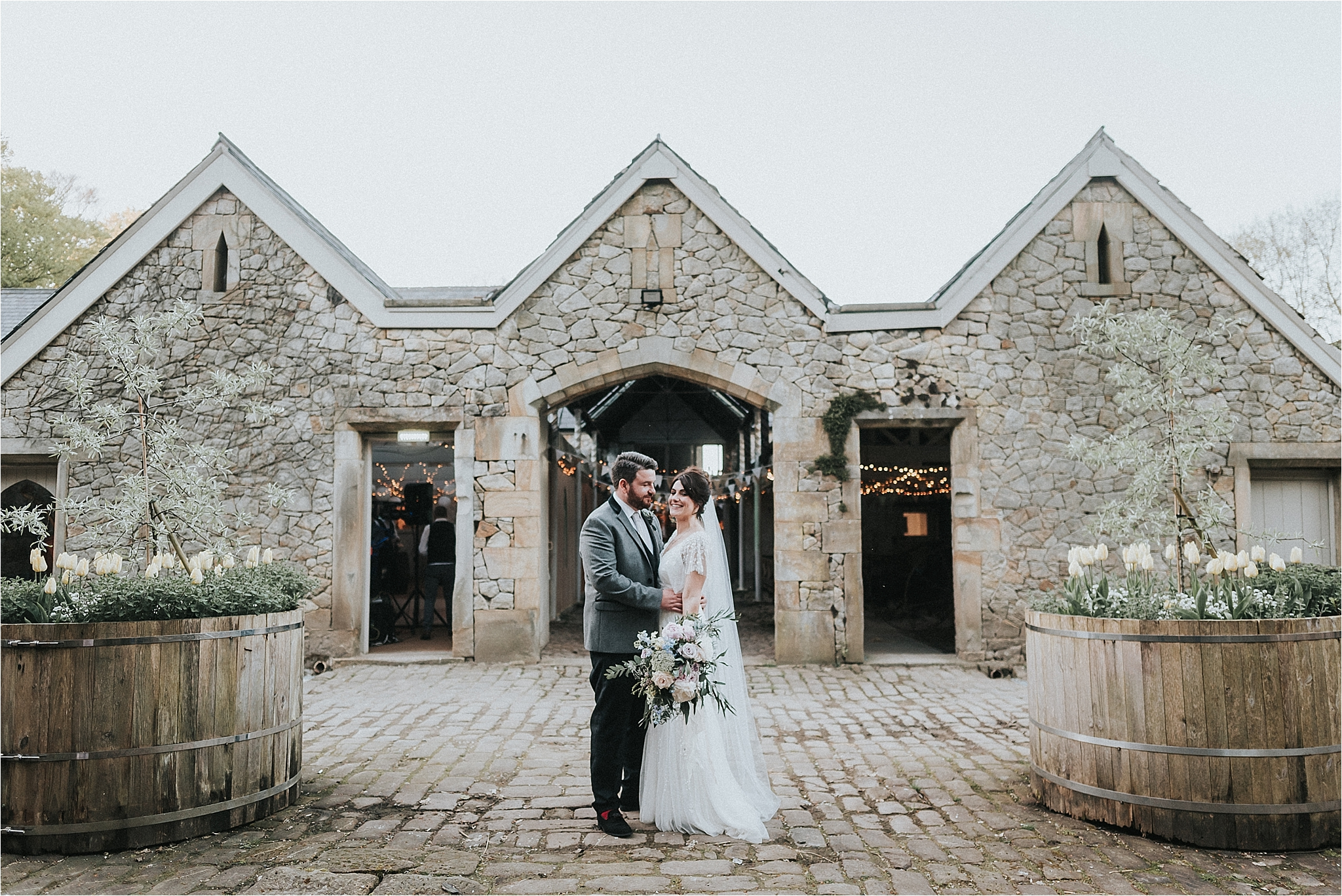 couple outside wyresdale park wedding barn