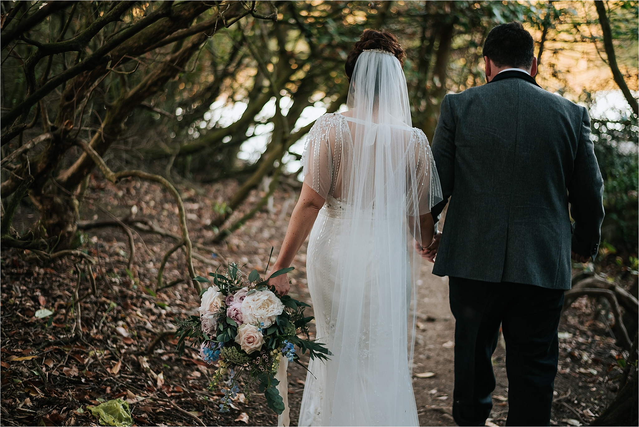 bride and groom walk to lake at wyresdale park