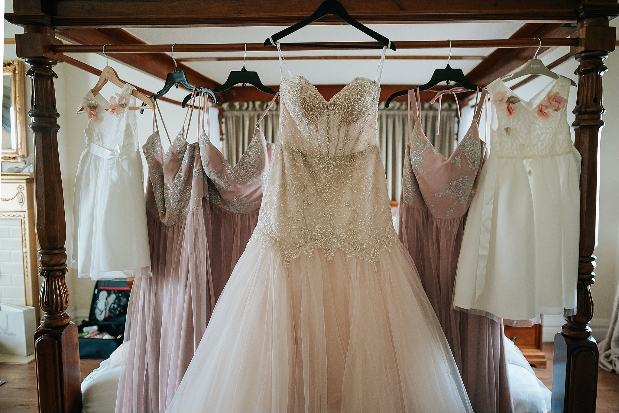 wedding dress hung on bed