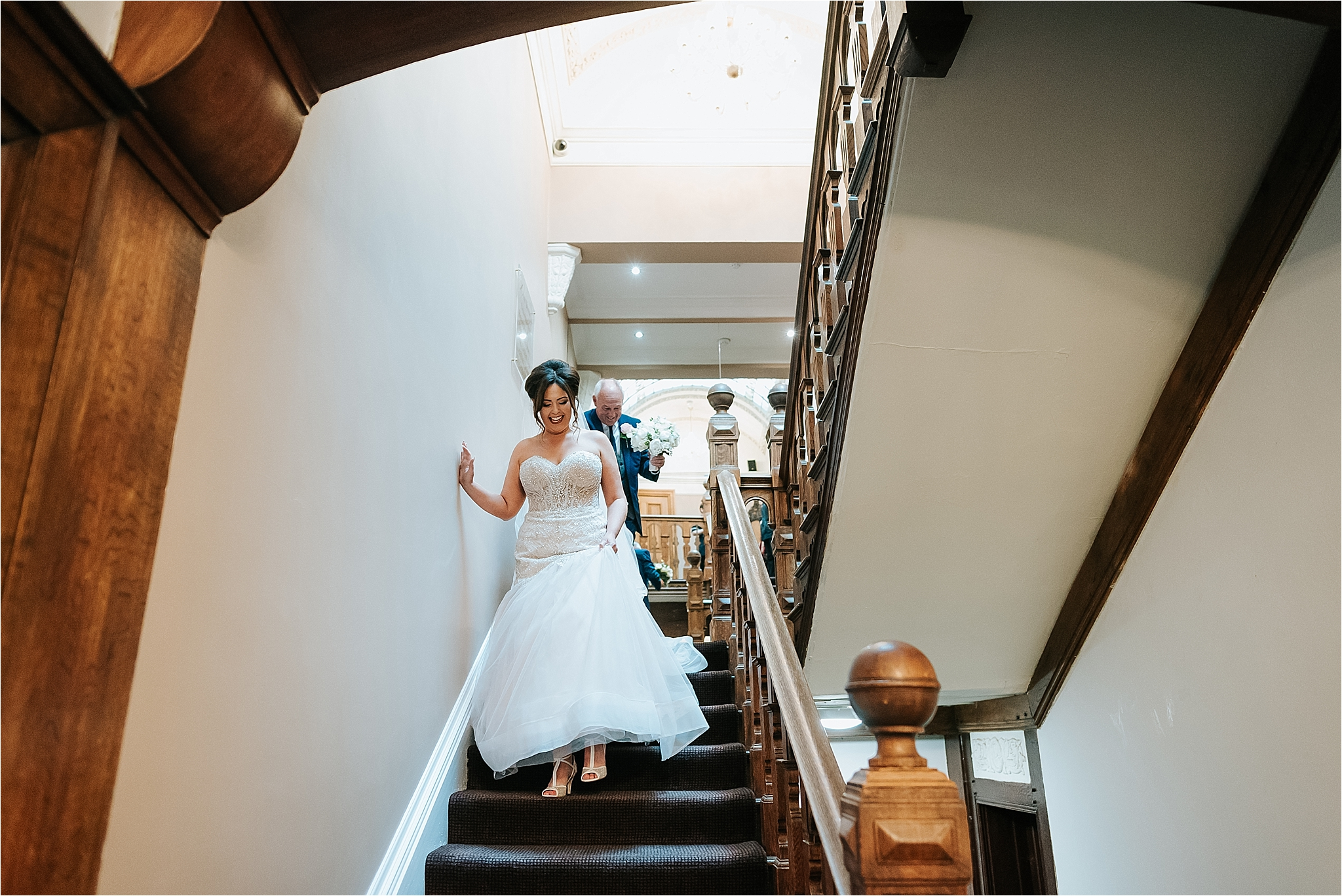 bride comes down stairs at west tower ormskirk