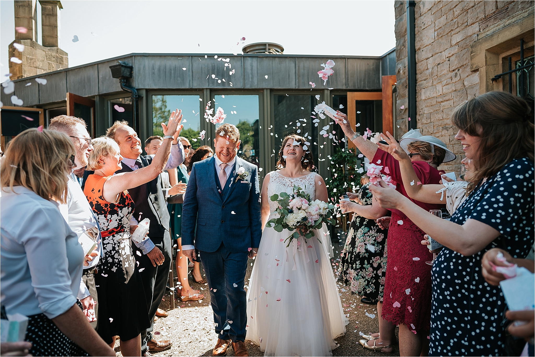 Bride and groom confetti shot at Clitheroe castle