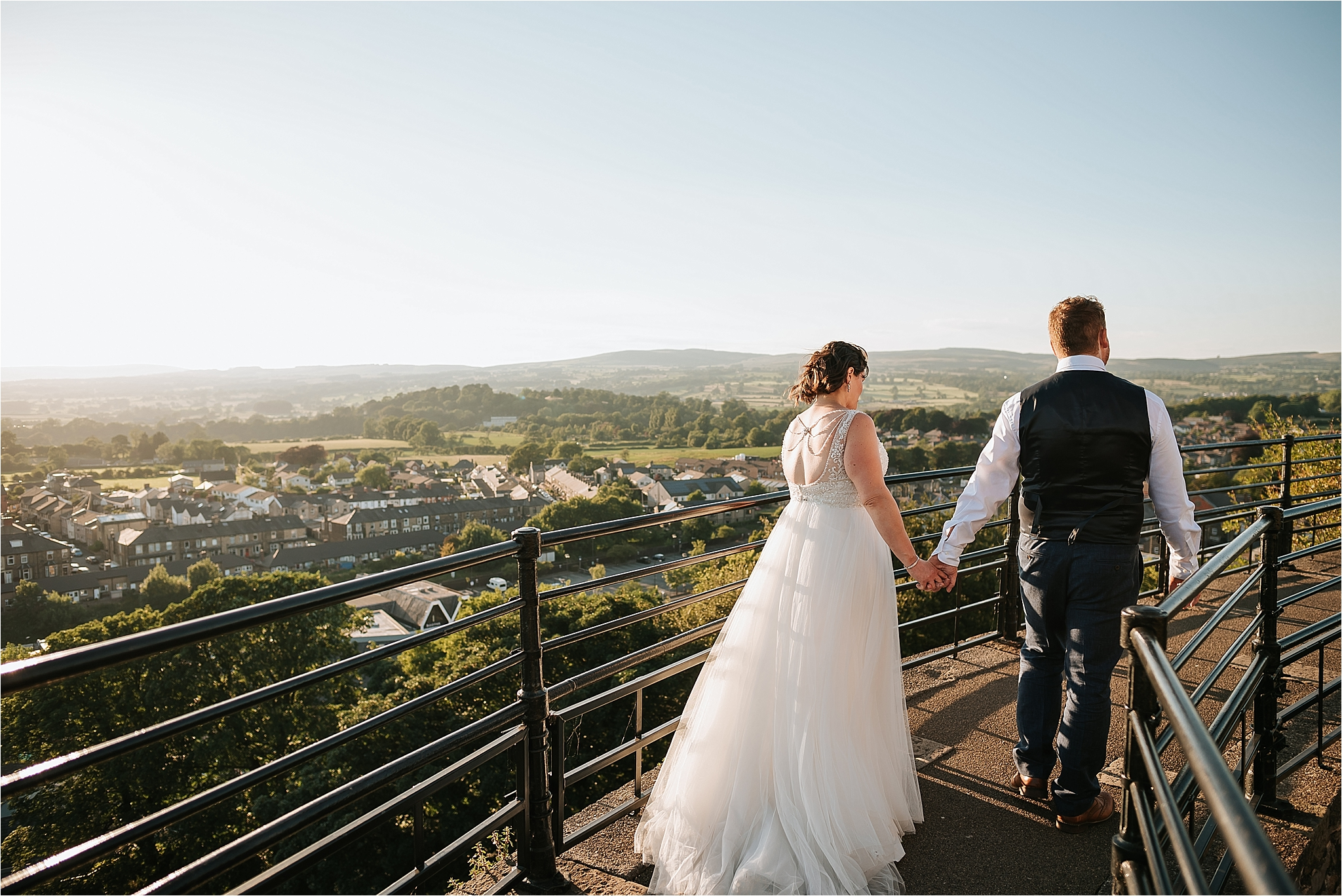 Bride and groom on top of clitheroe castle