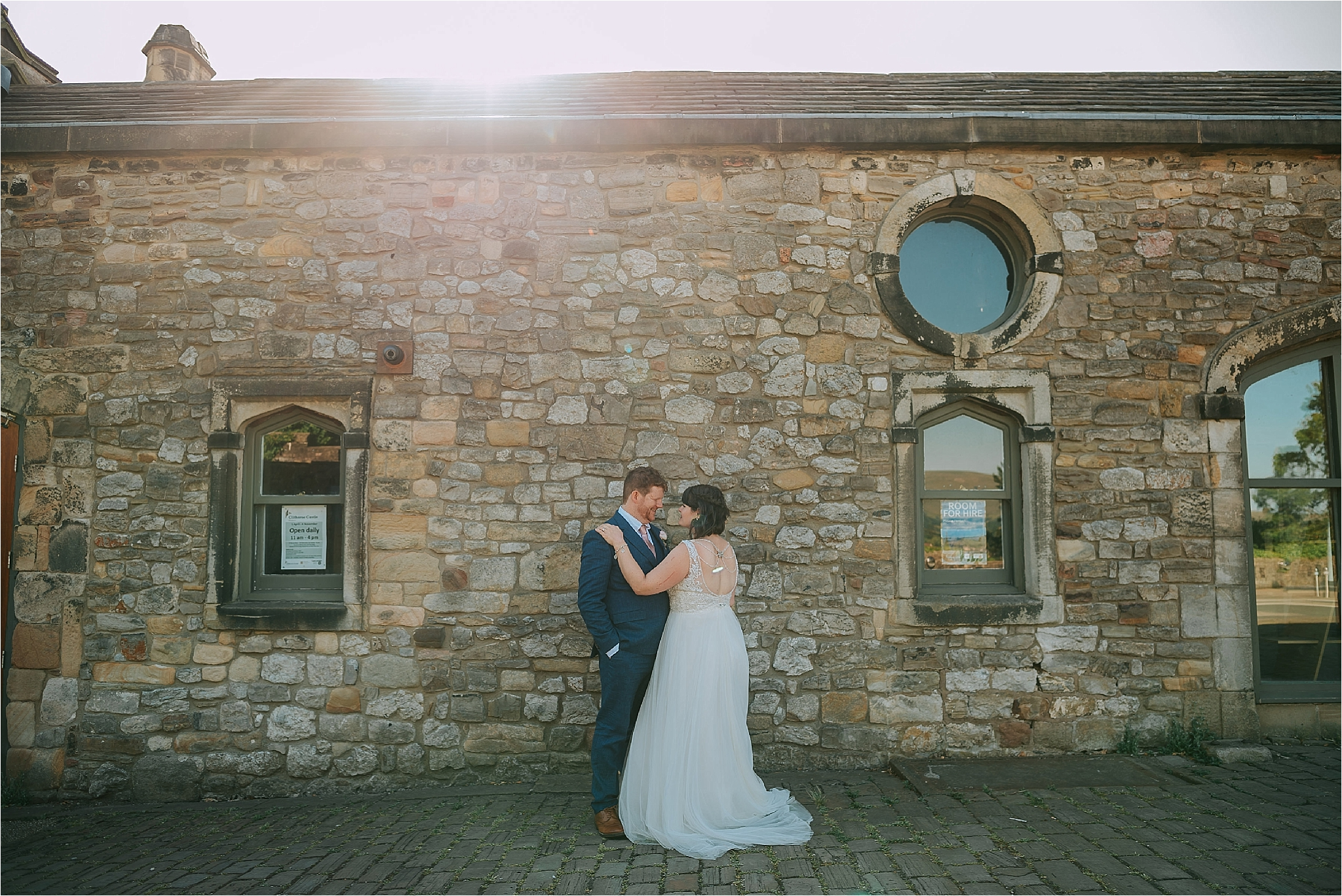 Couple at clitheroe castle after their wedding