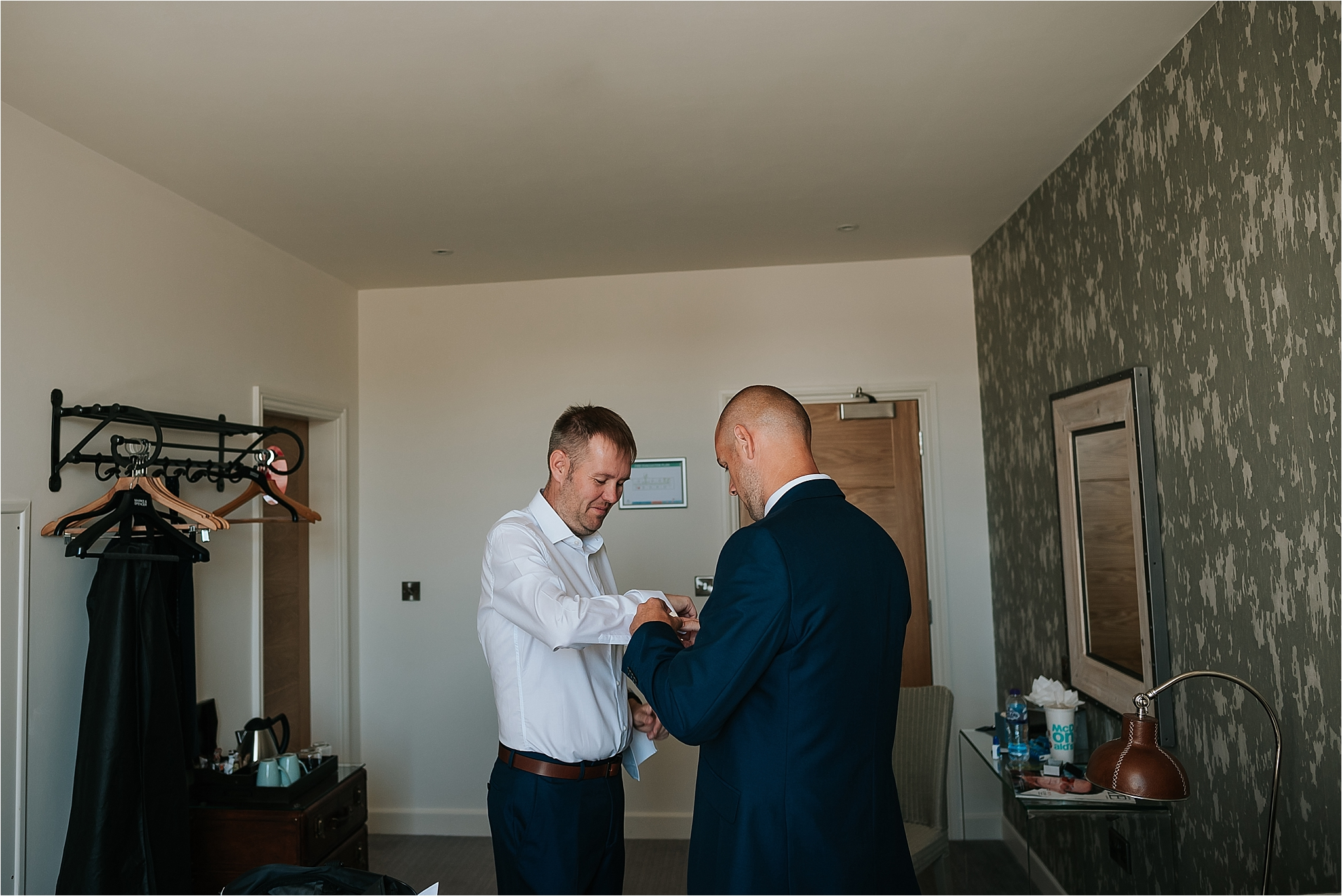 Groom getting ready before wedding at holmes mill