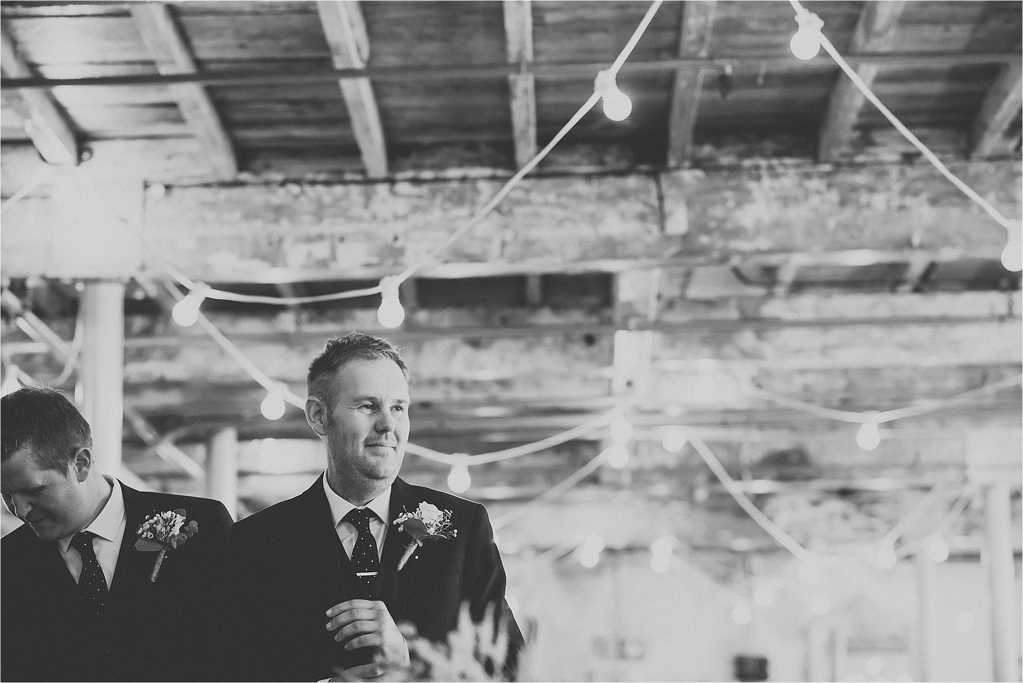 Groom in ceremony room at holmes mill, bowling brewery