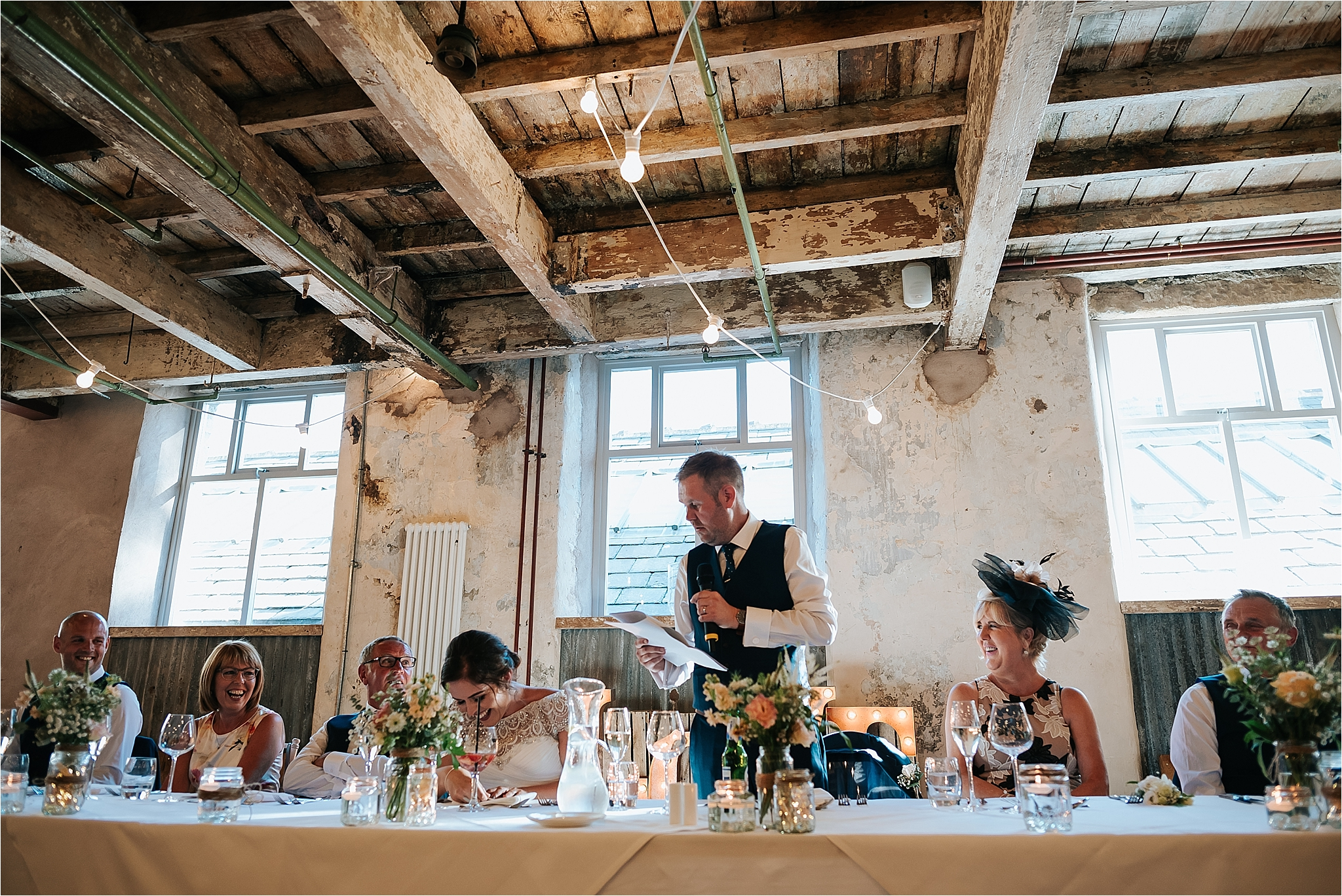 Groom doing a speech at Holmes Mill