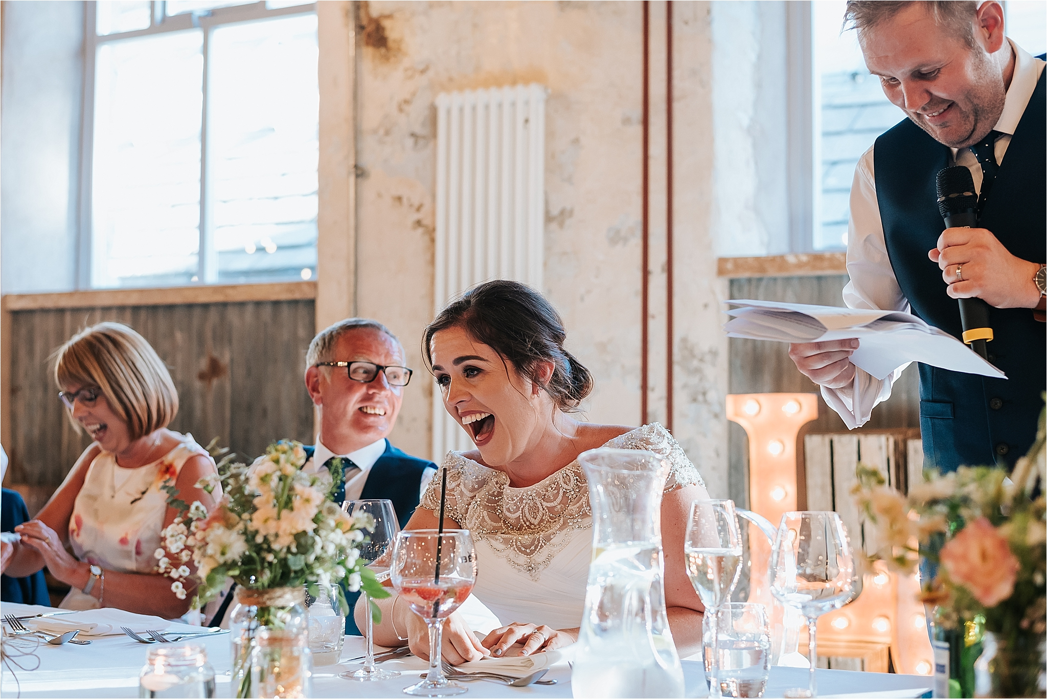 bride laughing at holmes mill wedding