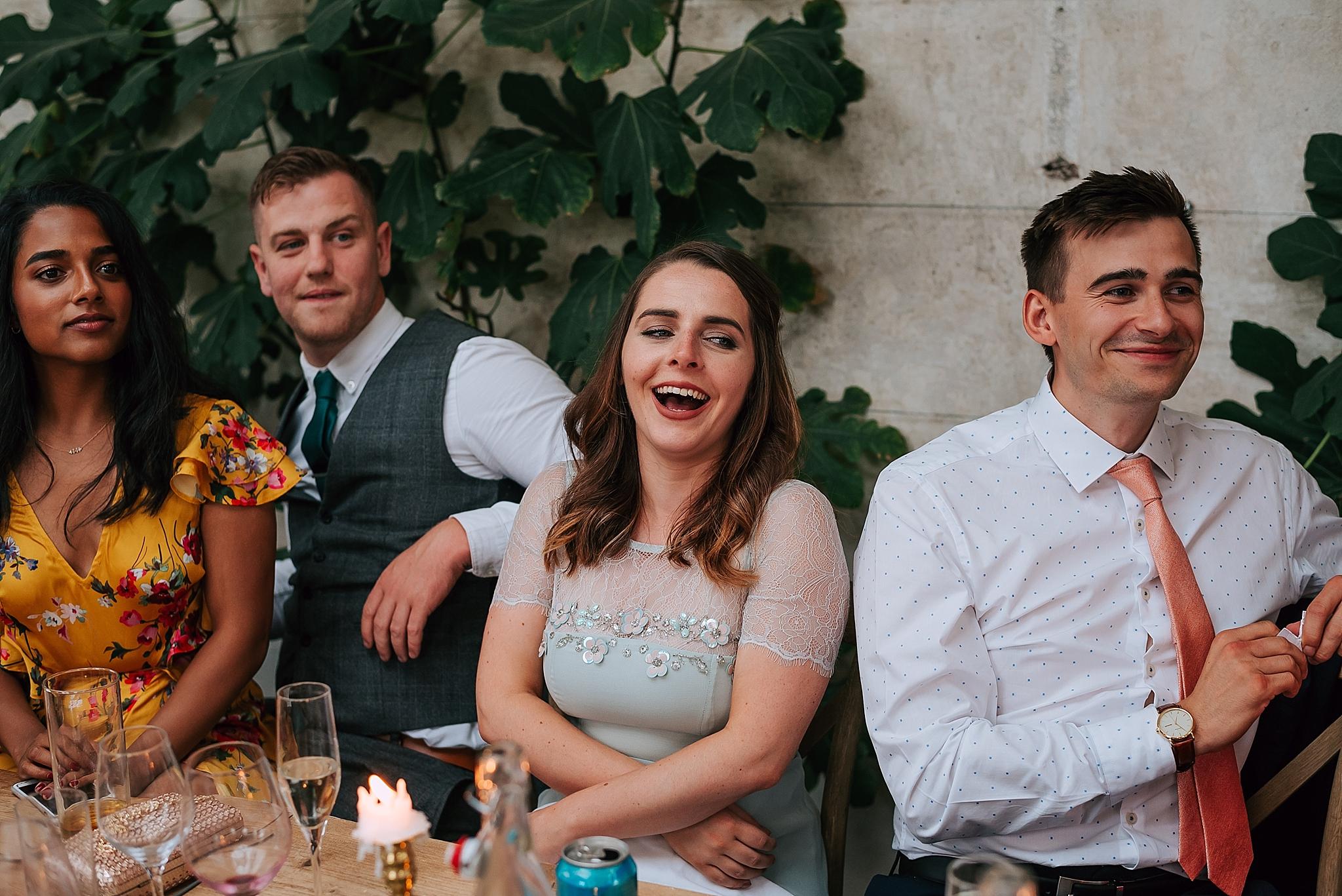 Enjoying the wedding speeches at rustic wedding venue near darlington