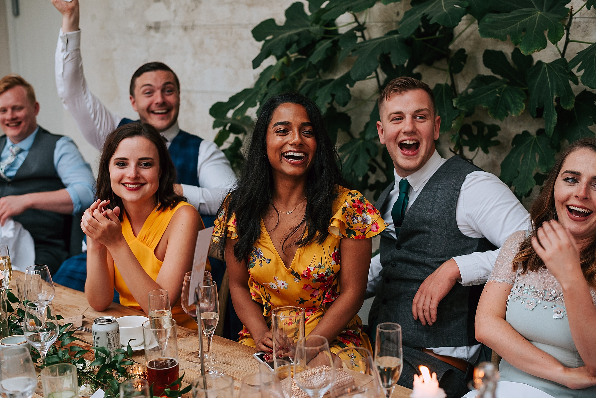 Guests laughing at rustic wedding venue north yorkshire